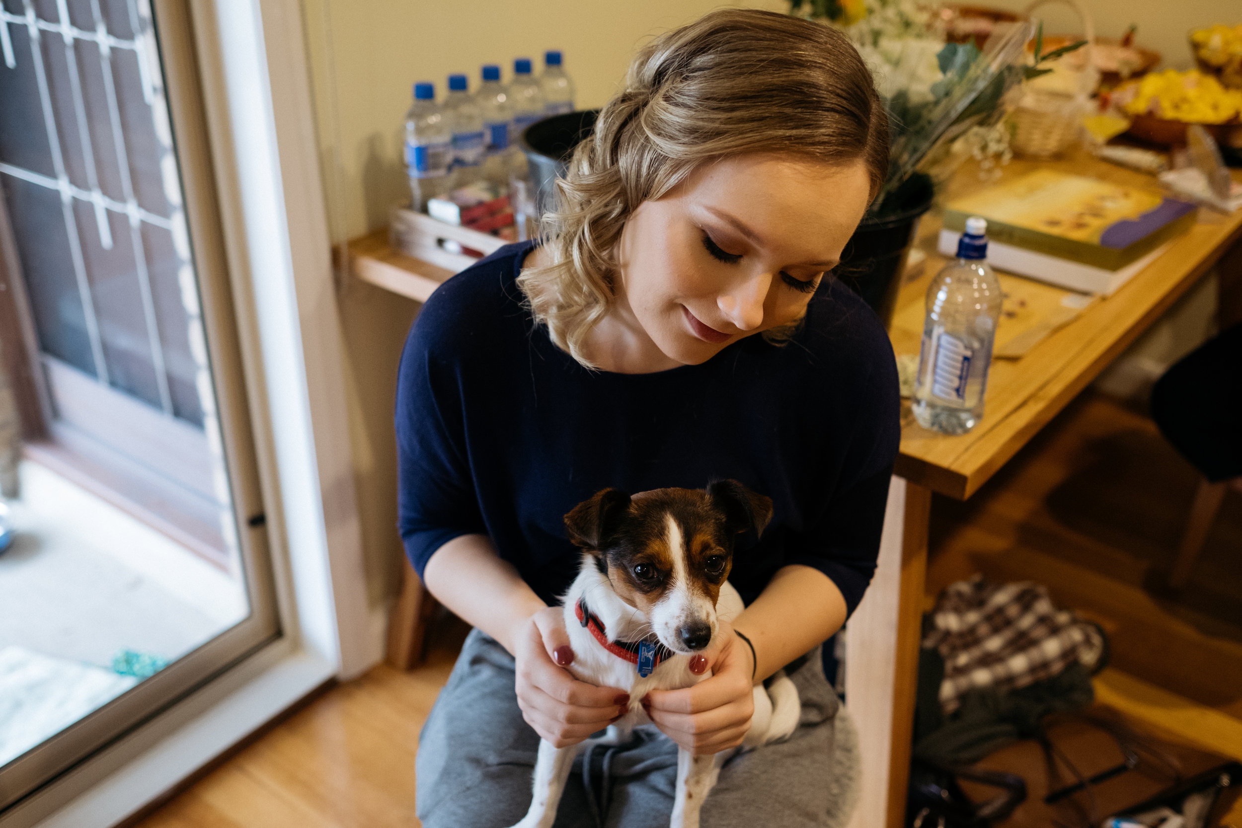 Sister of the groom holding Rosie the dog