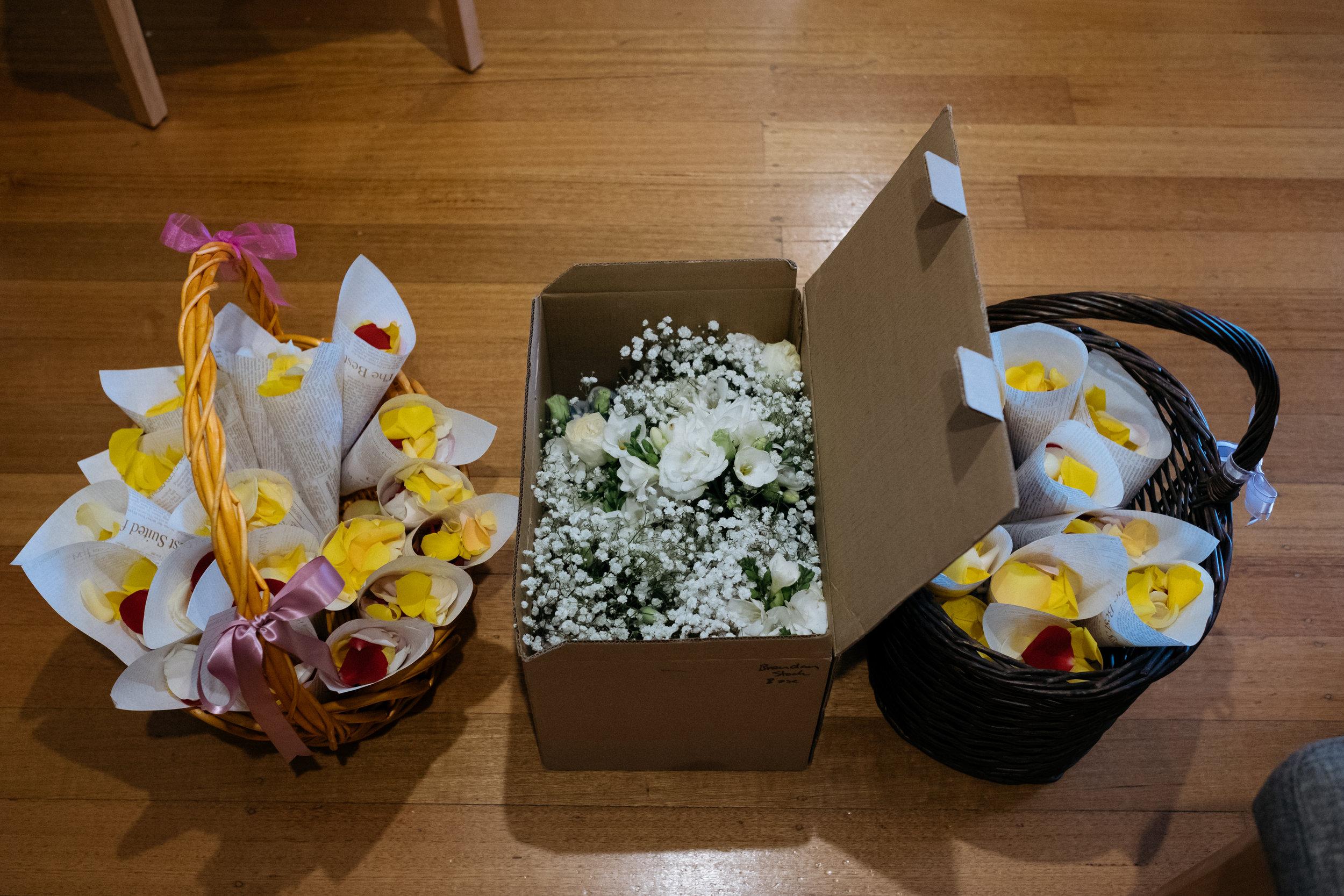 Baskets of rose petal confetti
