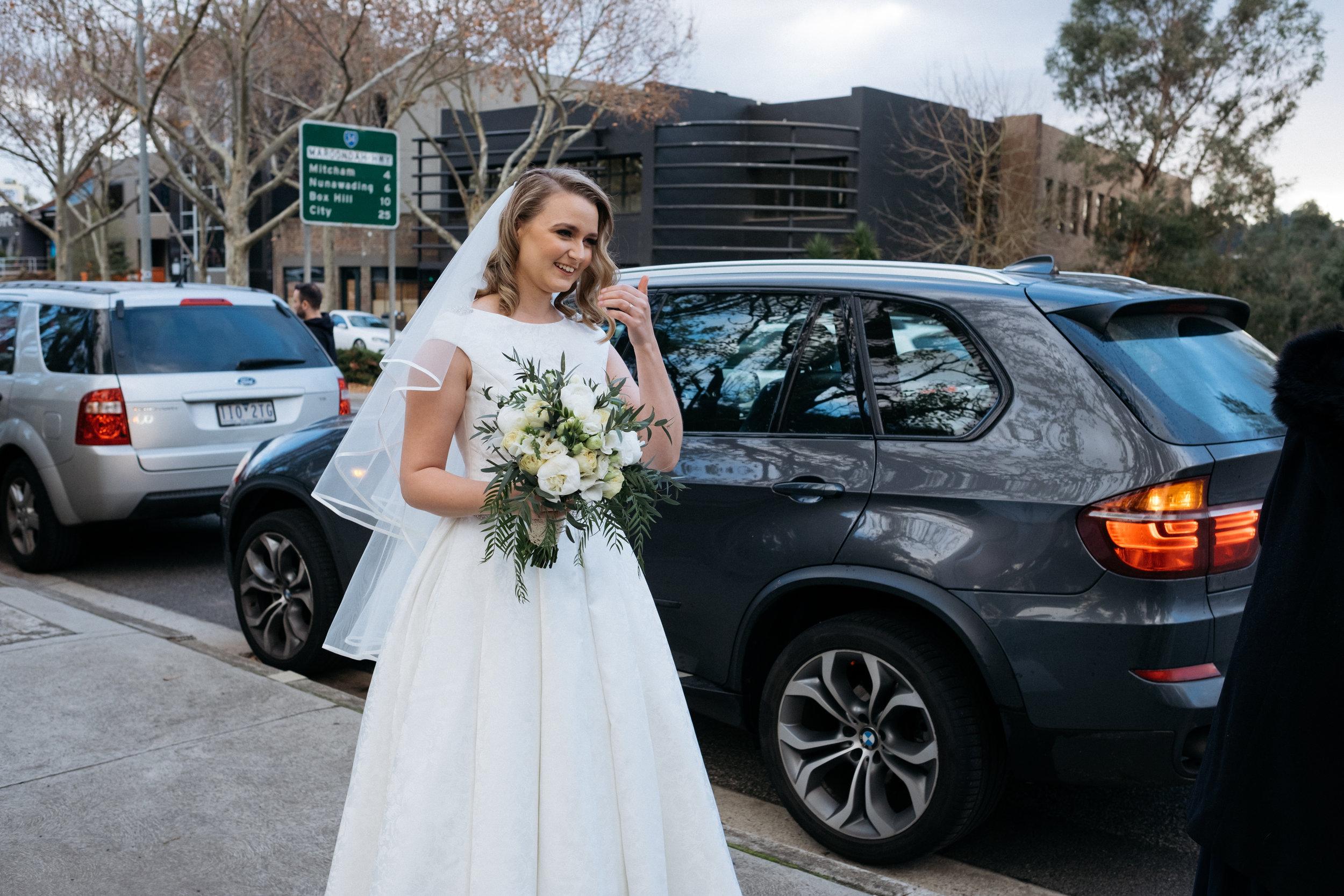 Beautiful bride waiting to go into wedding venue