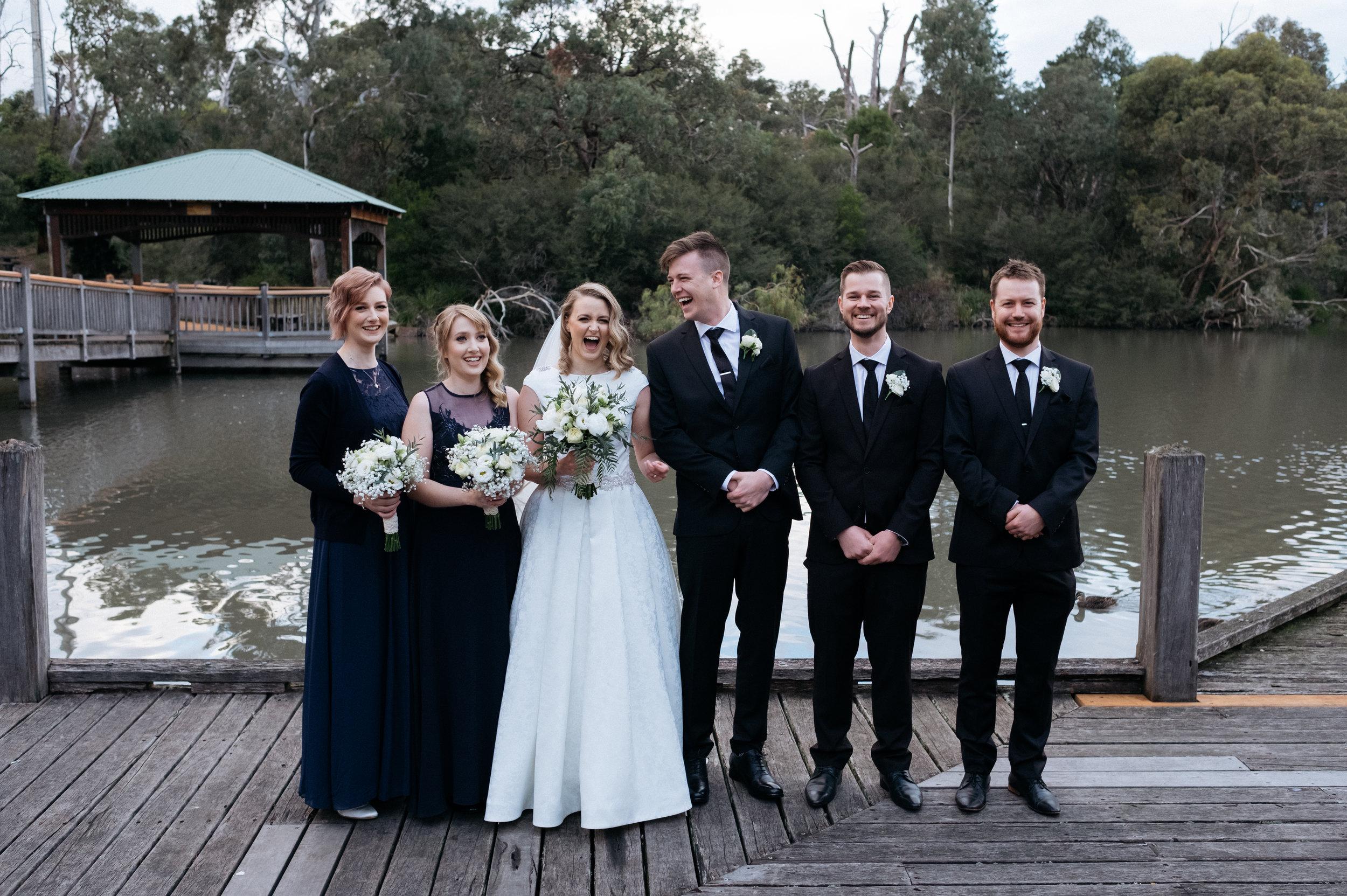 Bridal party laughing at Ringwood Lake Park, VIC