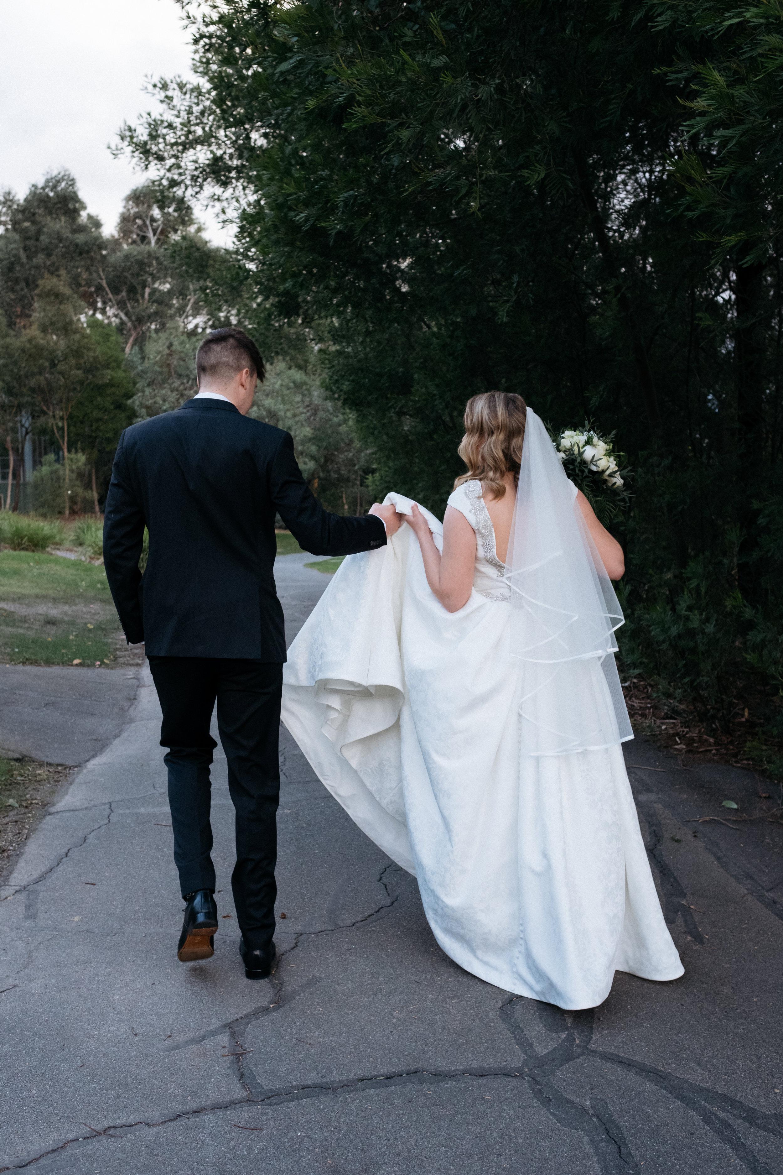 Bride and groom walking through Ringwood Lake Park, VIC