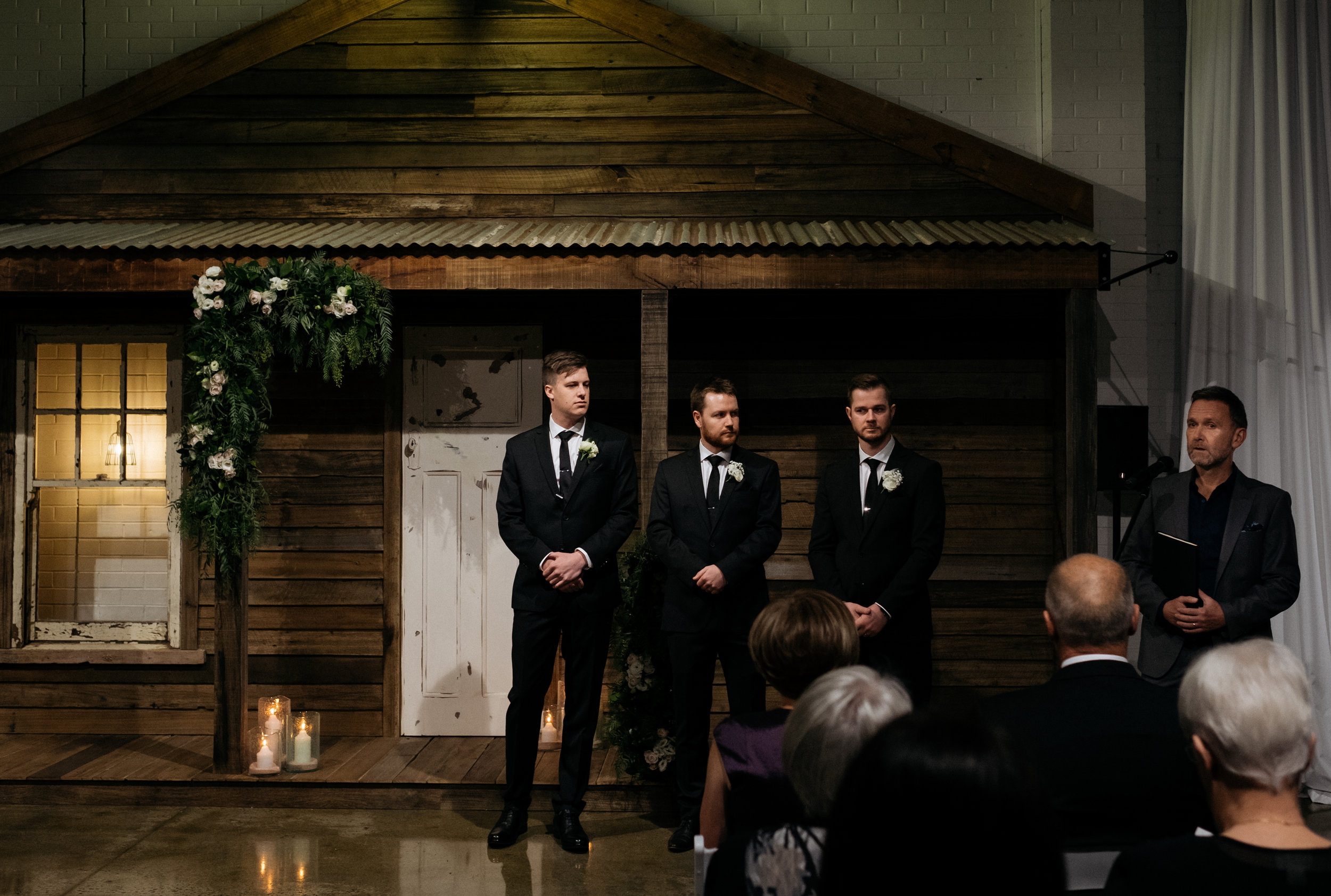 Groom, groomsmen and officiant awaiting the bride
