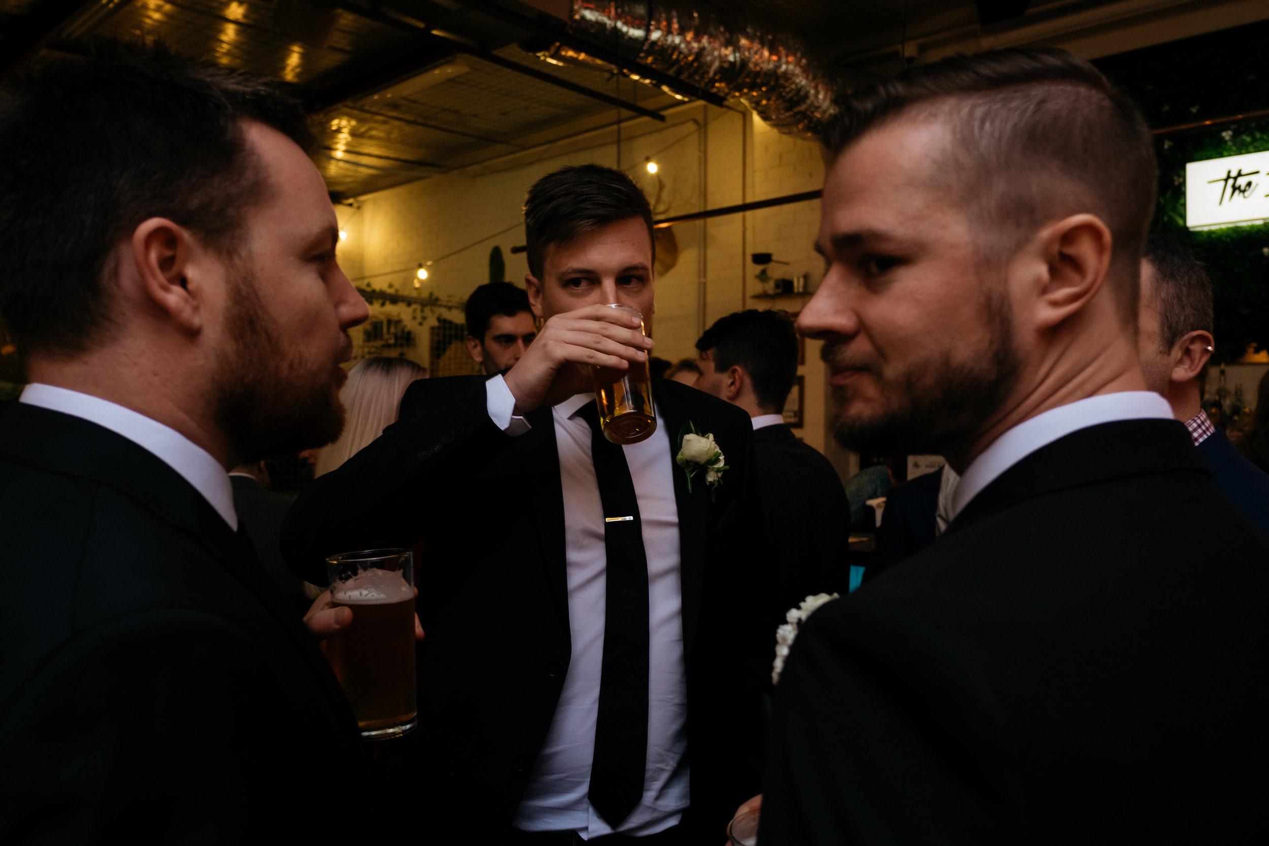 Groom drinking a pint of beer