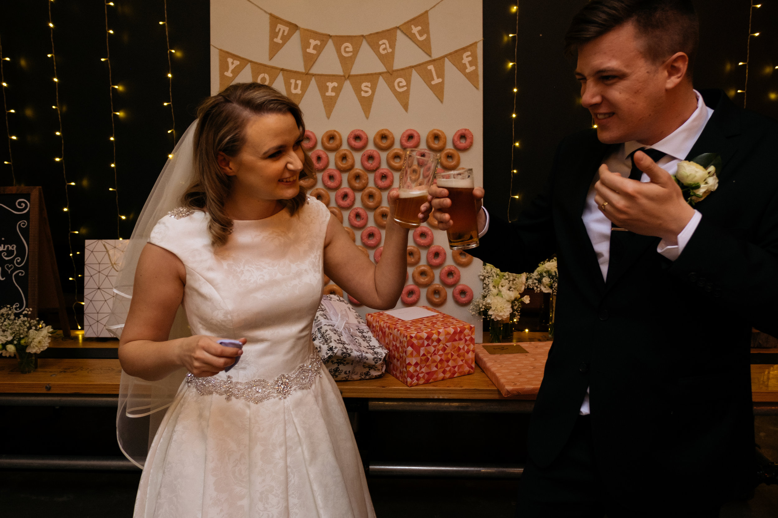 Bride and groom drinking beer after wedding ceremony