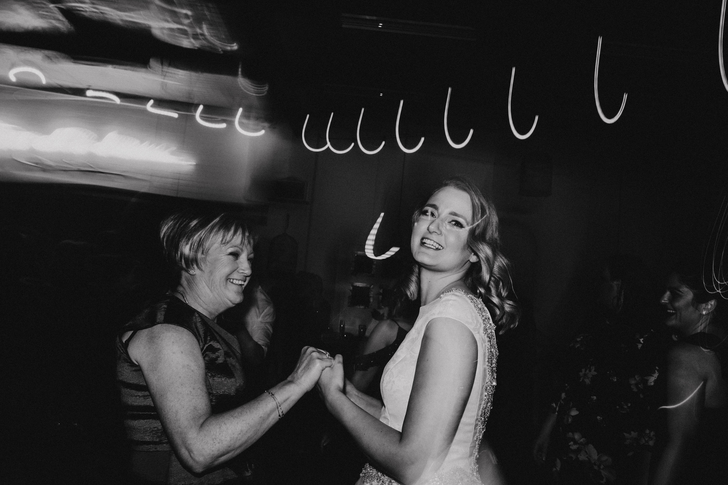 Bride dancing with the mother of the groom