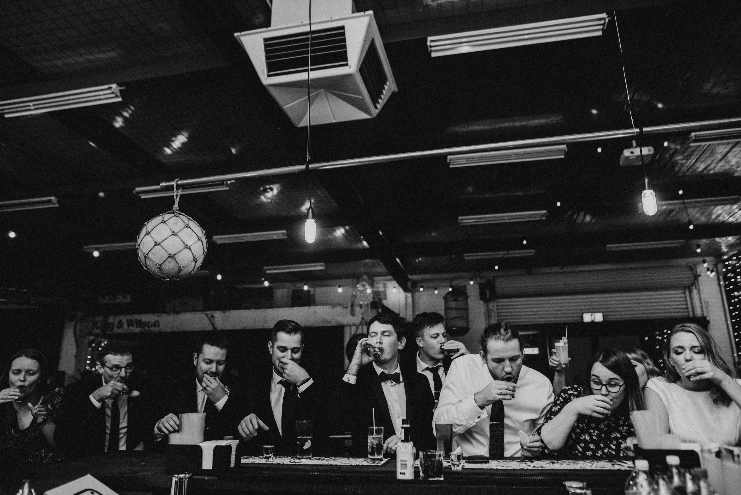 Wedding guests take shots at the bar at The Budgie Smuggler, Ringwood, VIC