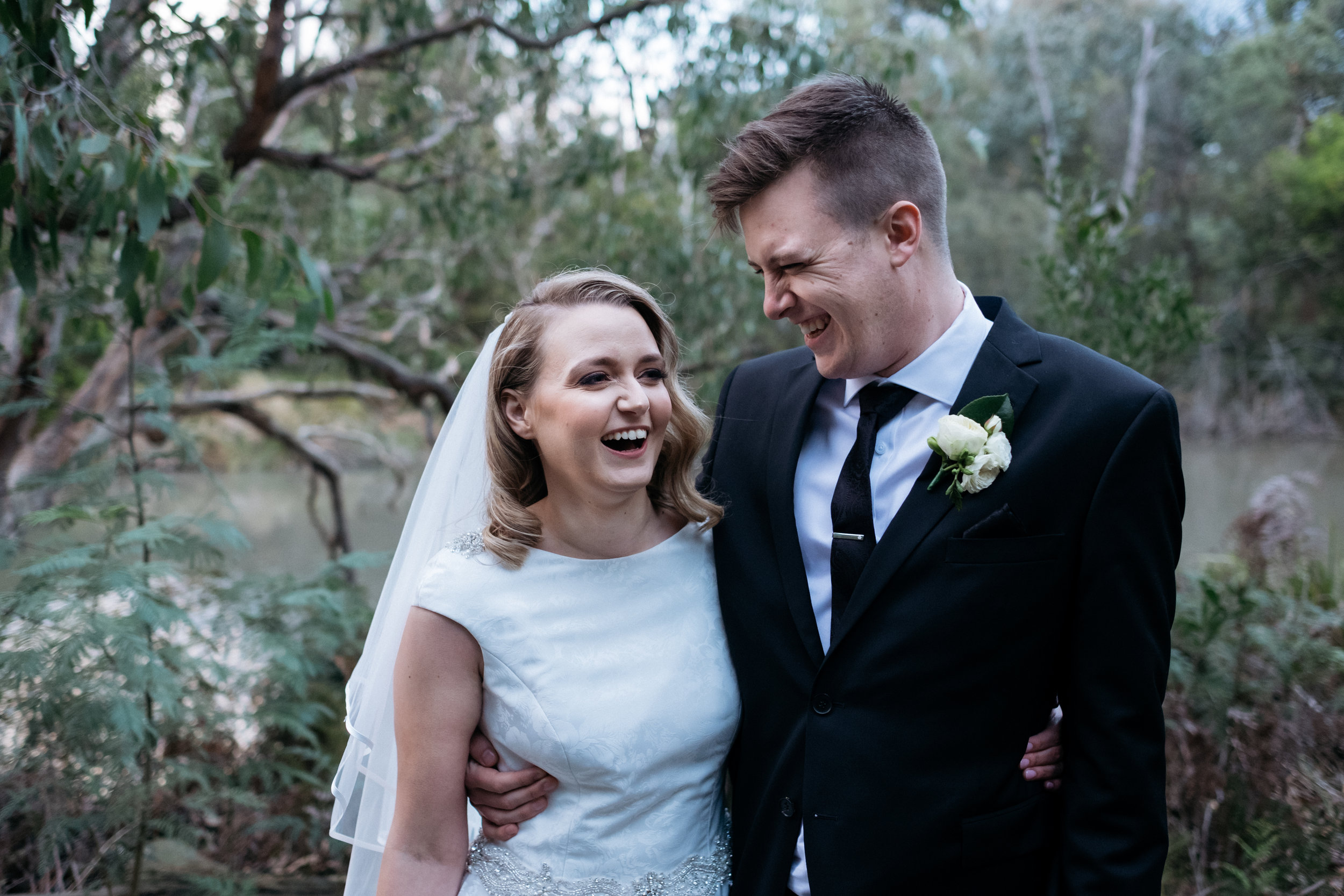 Bride and groom laughing during portraits at Ringwood Lake Park, Ringwood, VIC