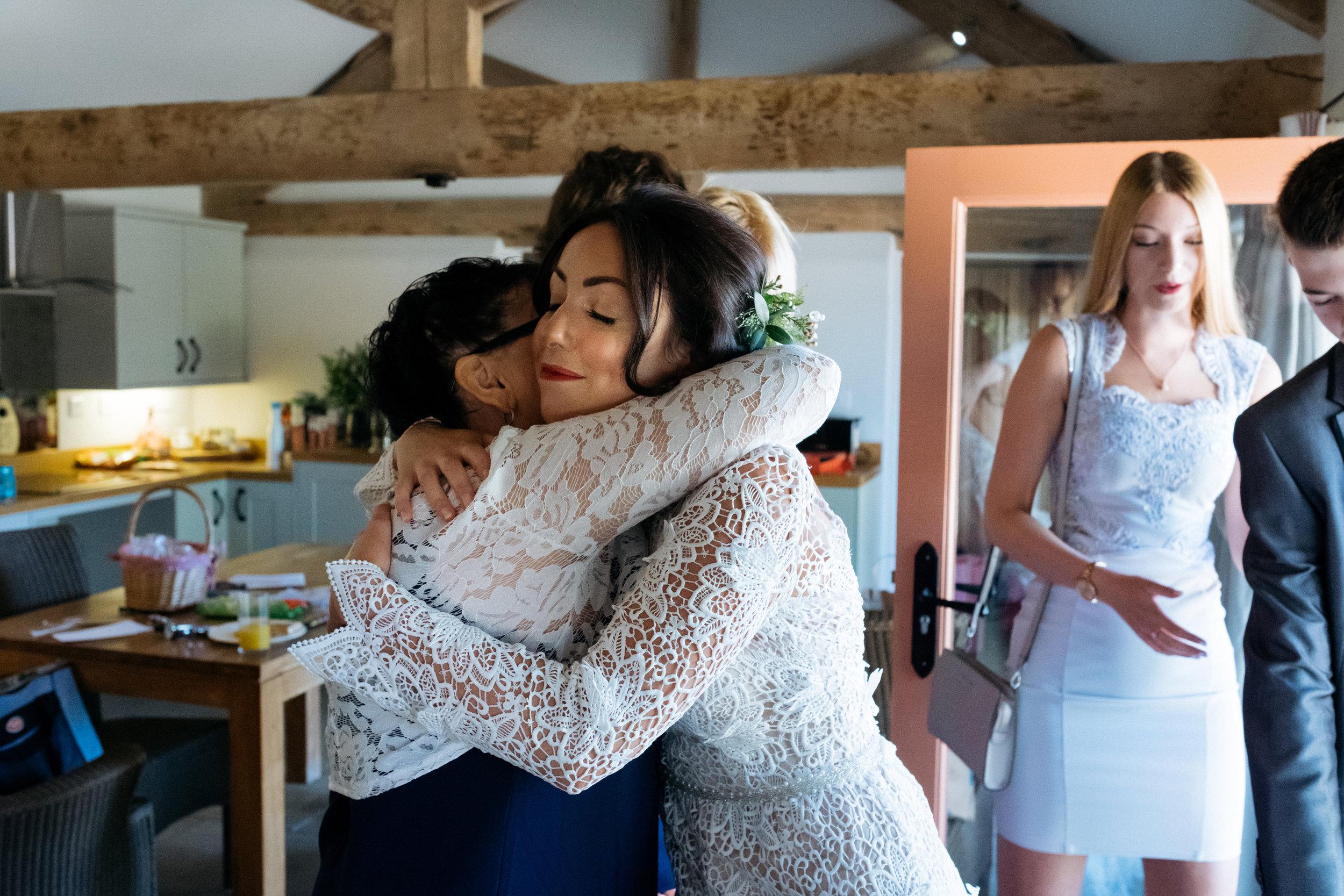 Bride hugging her mother on wedding day