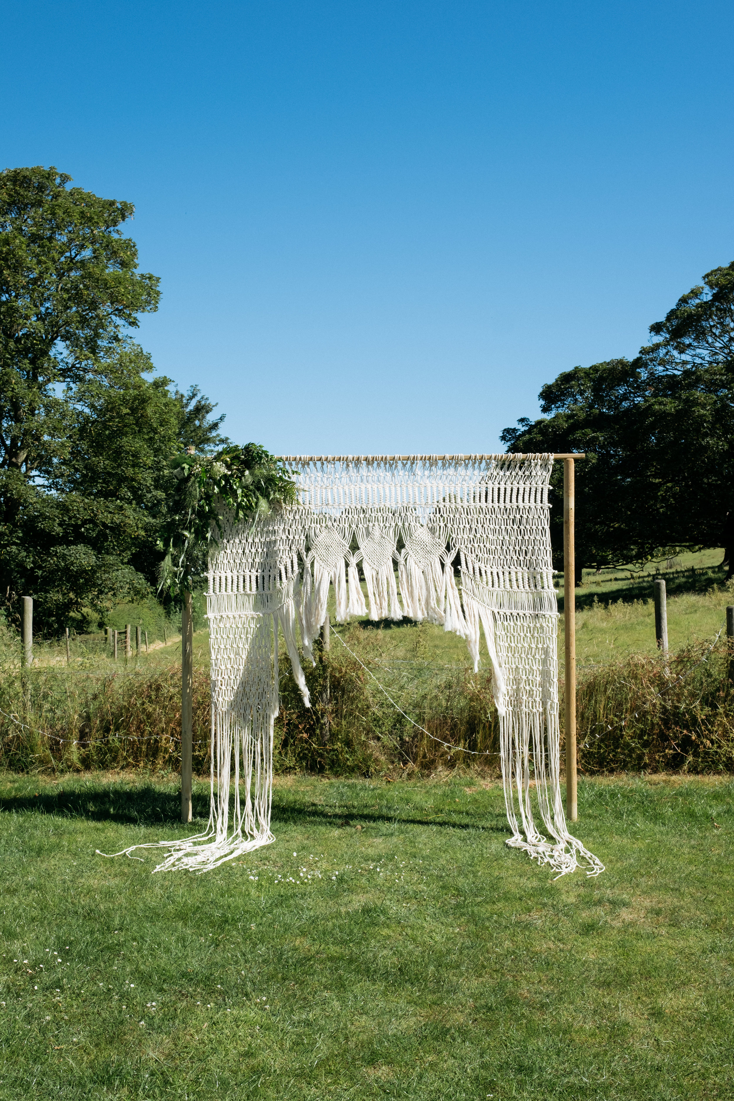 Macrame wedding arch surrounded by Lincolnshire countryside