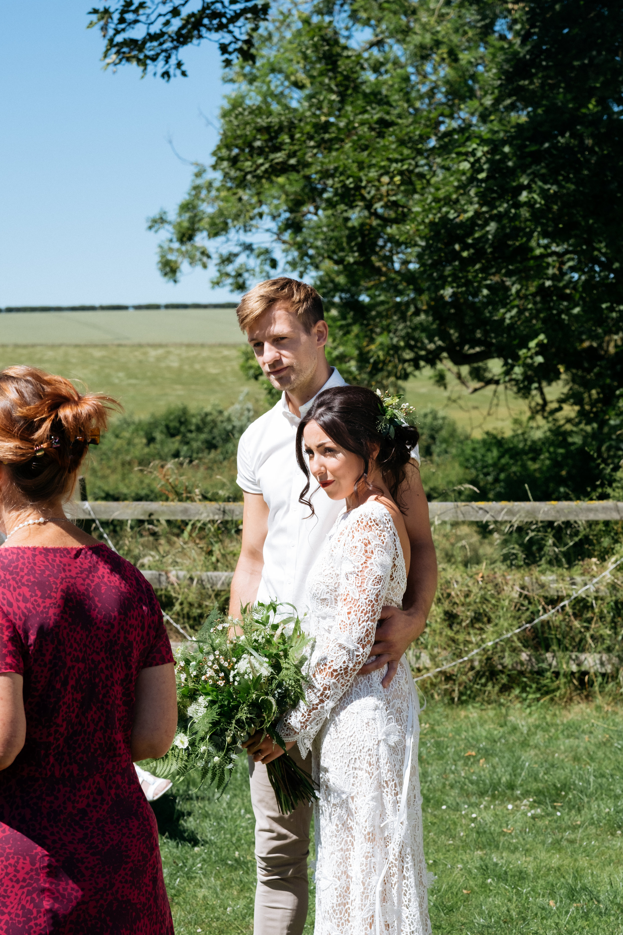 Bride and groom getting married in outdoor wedding ceremony in Lincolnshire countryside