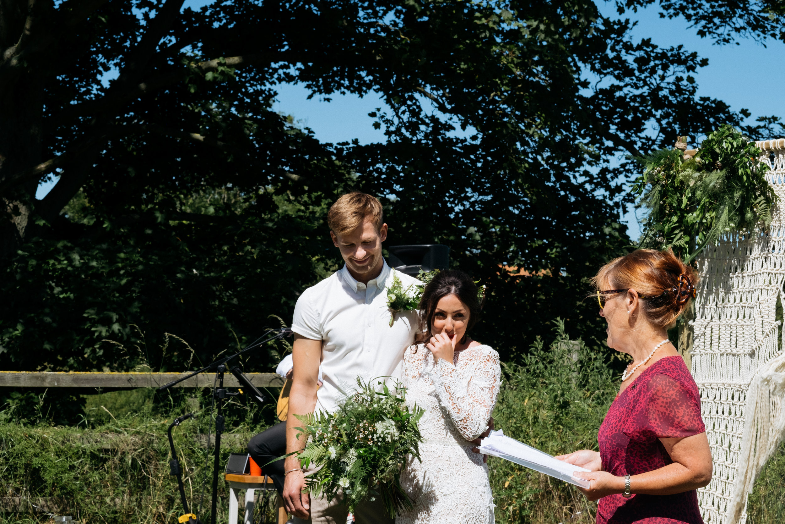 Couple laughing through outdoor wedding ceremony