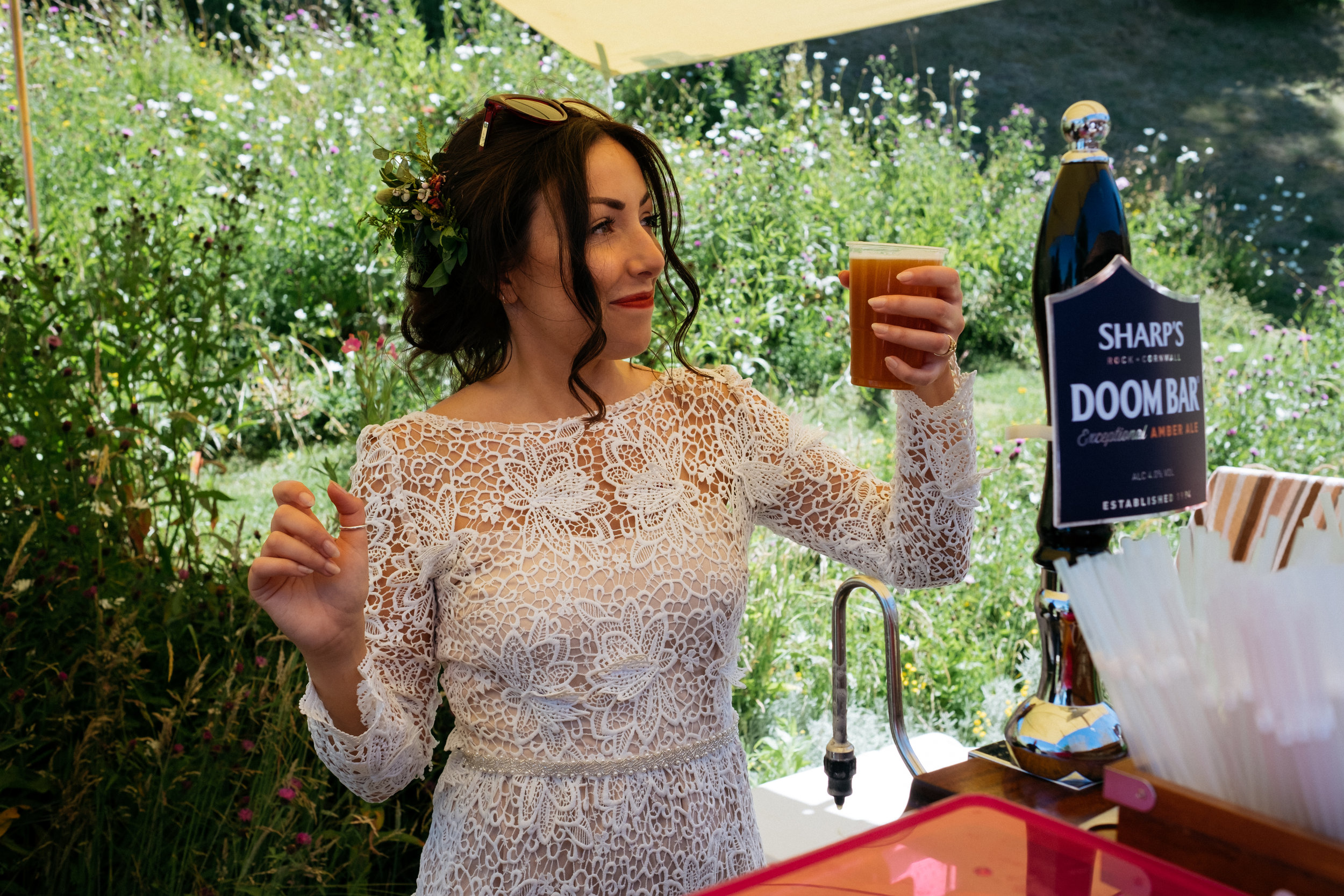 Bride proudly holds her pint of ale