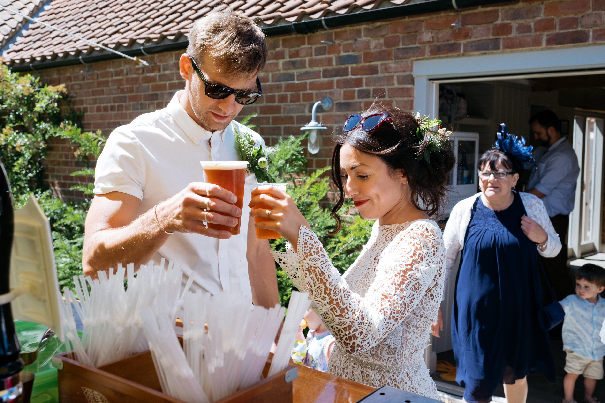 Bride and groom cheers with their ales