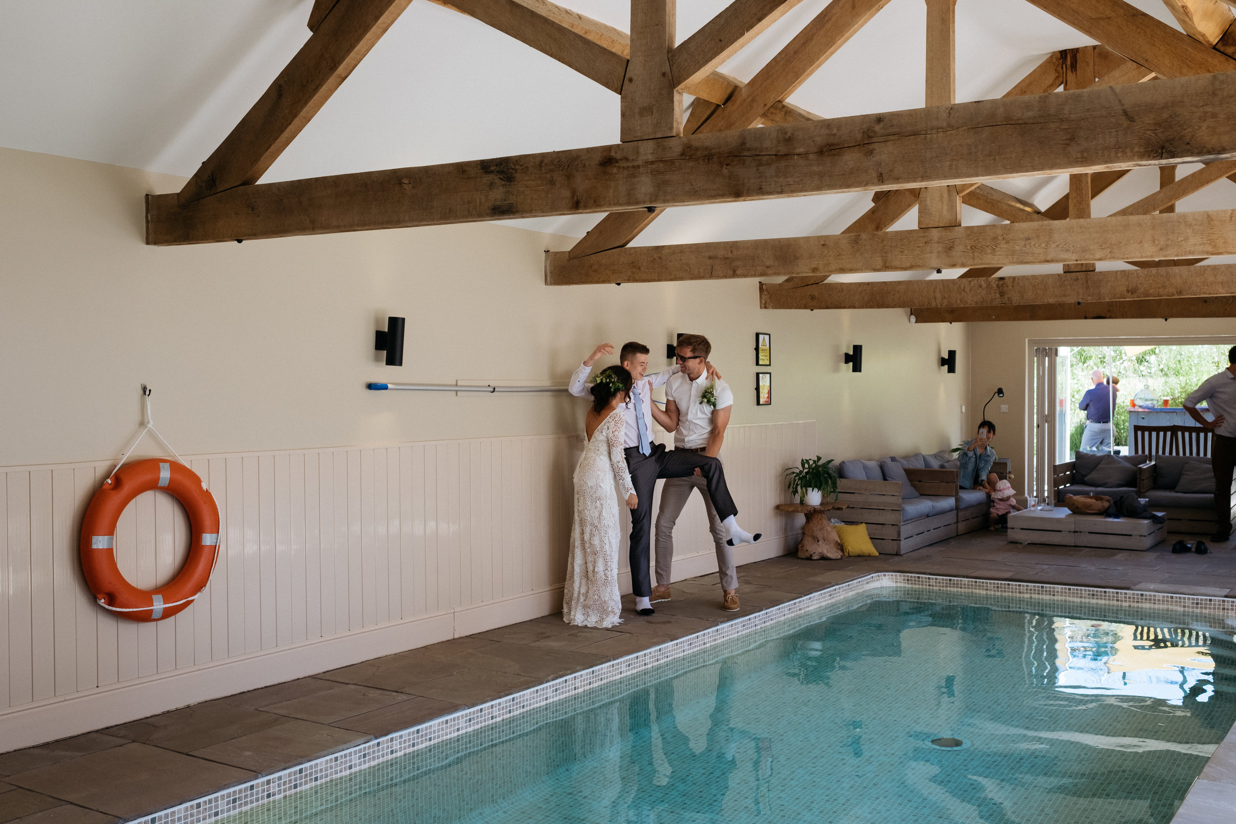 Bride and groom throw guest into swimming pool