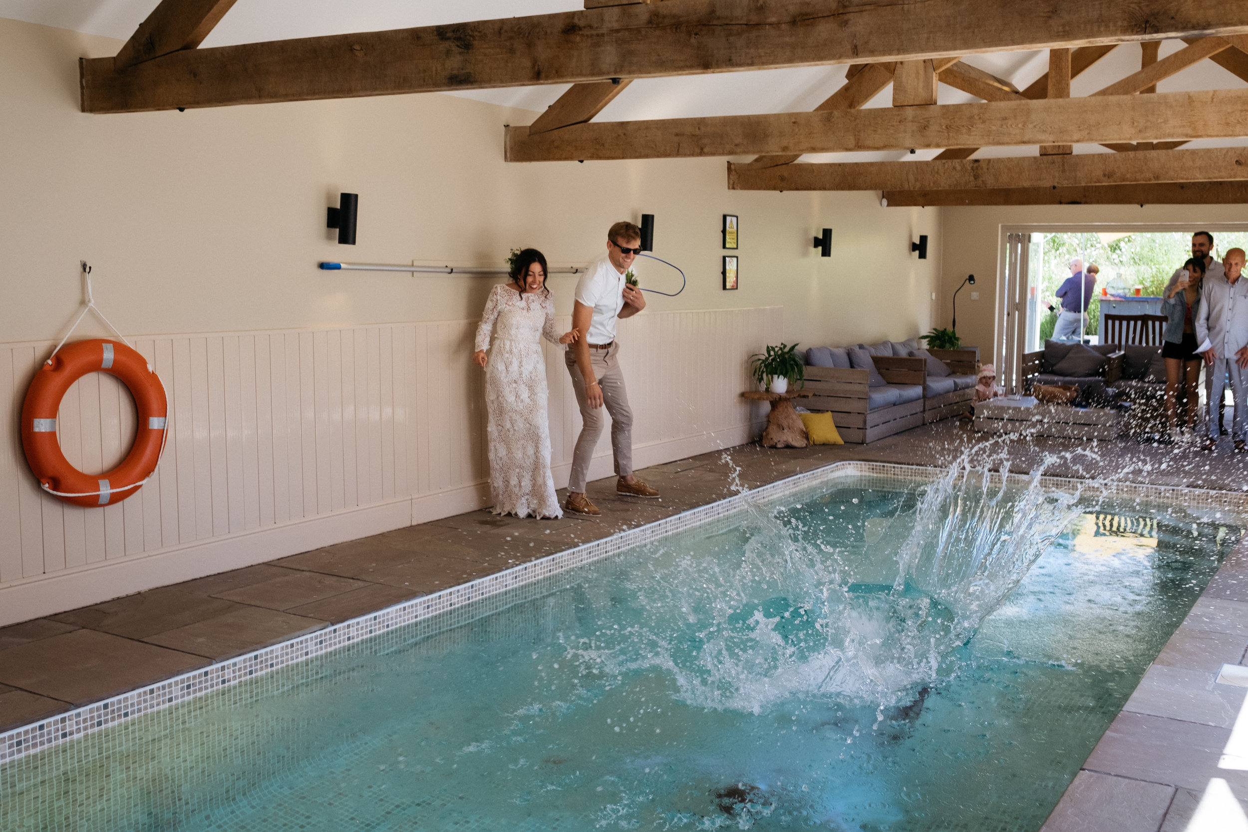 Wedding guest gets thrown into the swimming pool by bride and groom