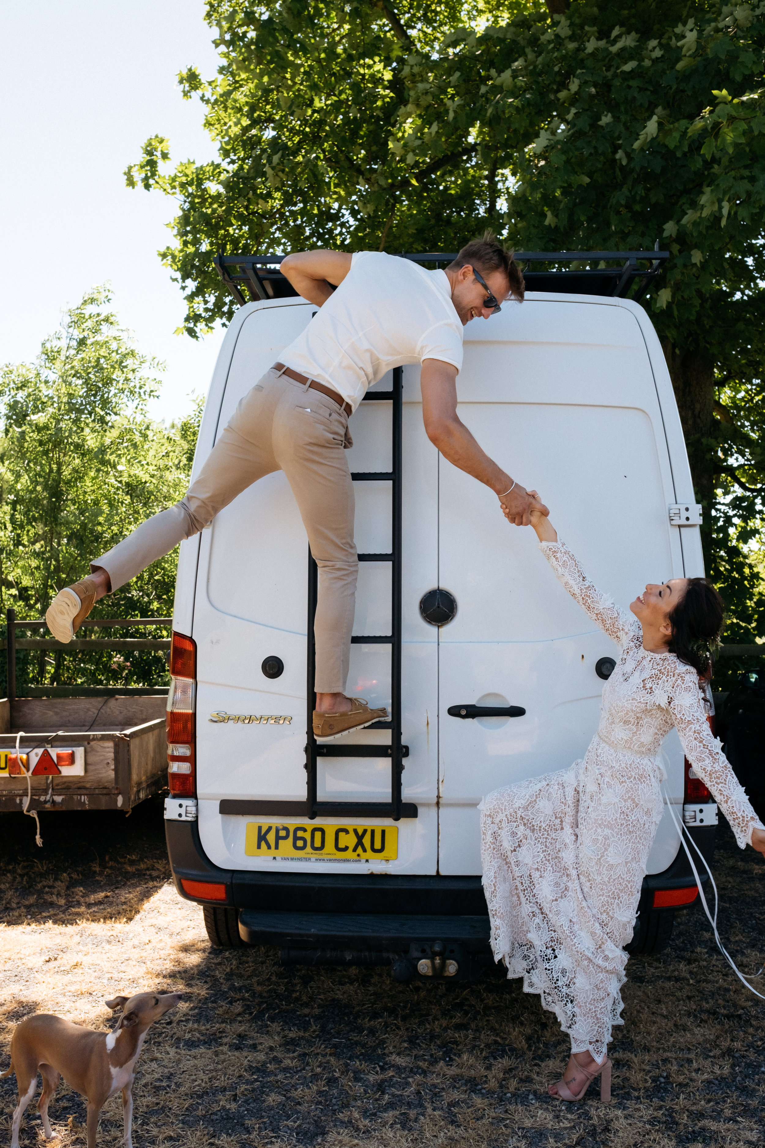 Bride and groom living the van life on their wedding day