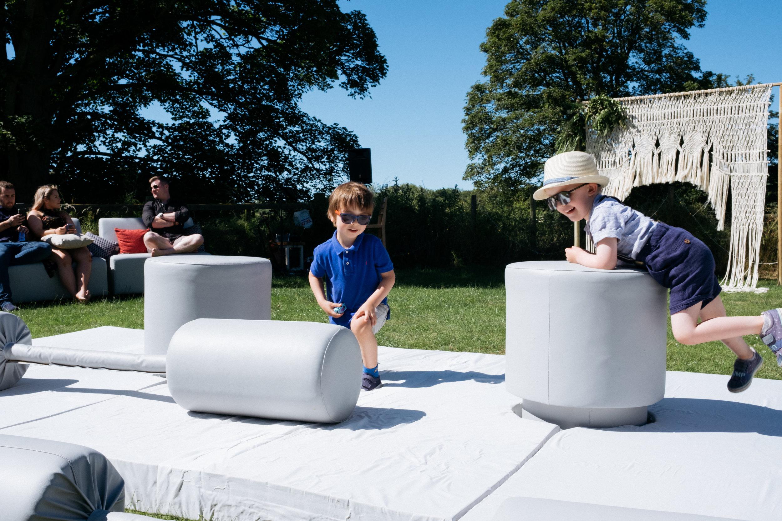 Children playing around at outdoor wedding