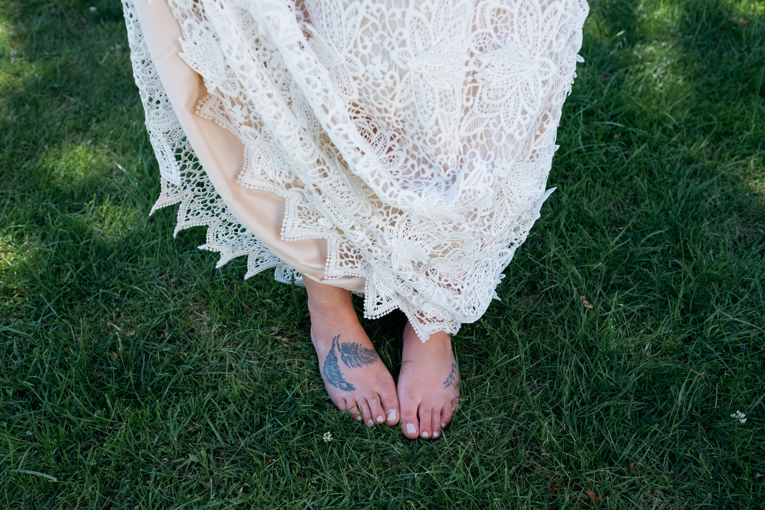 Barefoot bohemian bride with alternative lace wedding dress