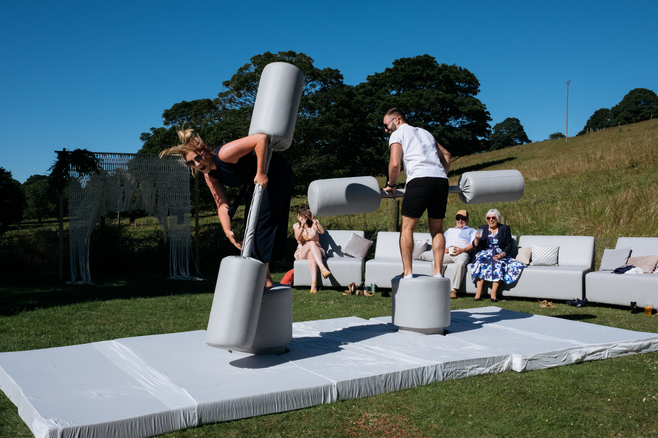 Wedding guests playing gladiator outdoor games