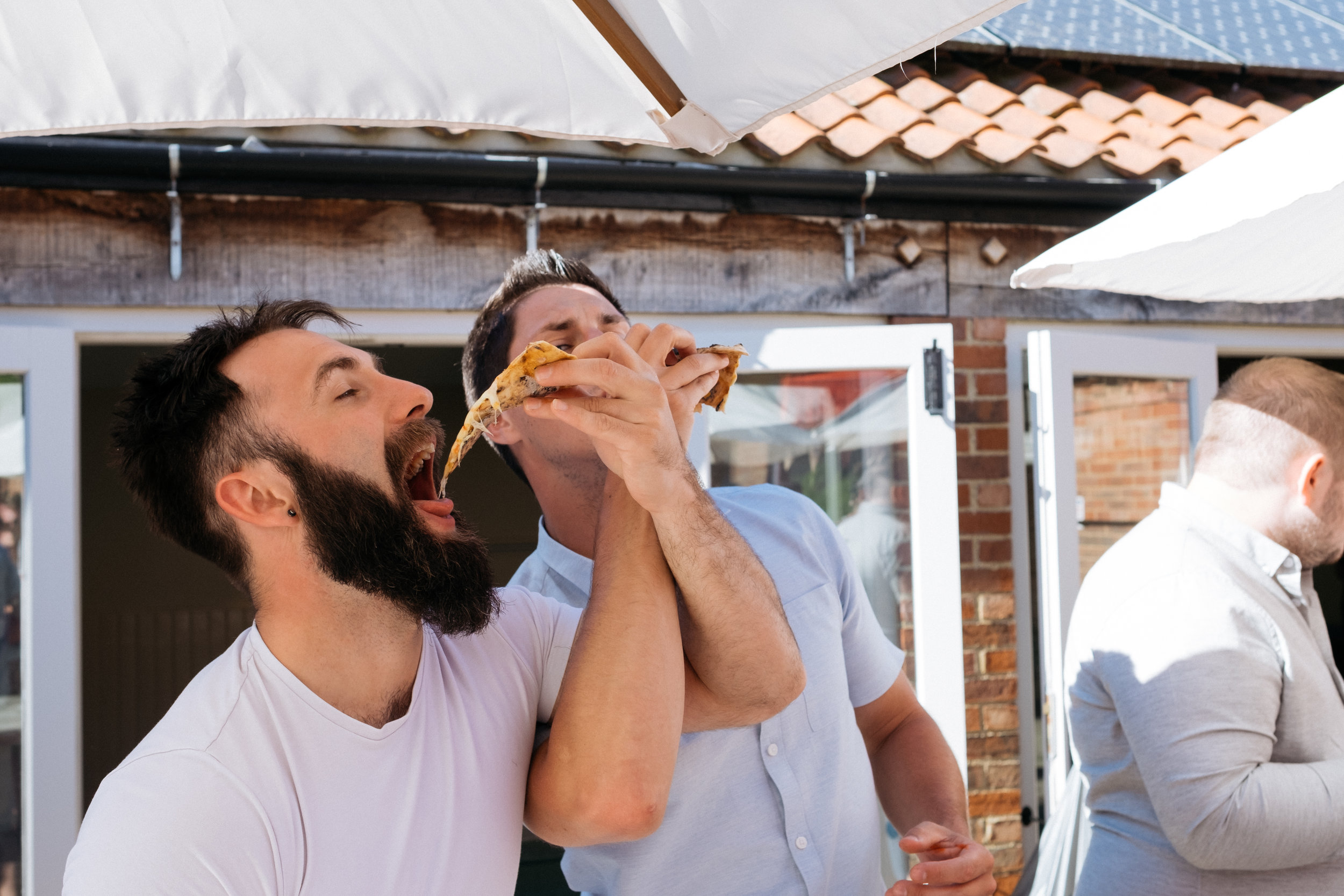 Wedding guests devouring pizza
