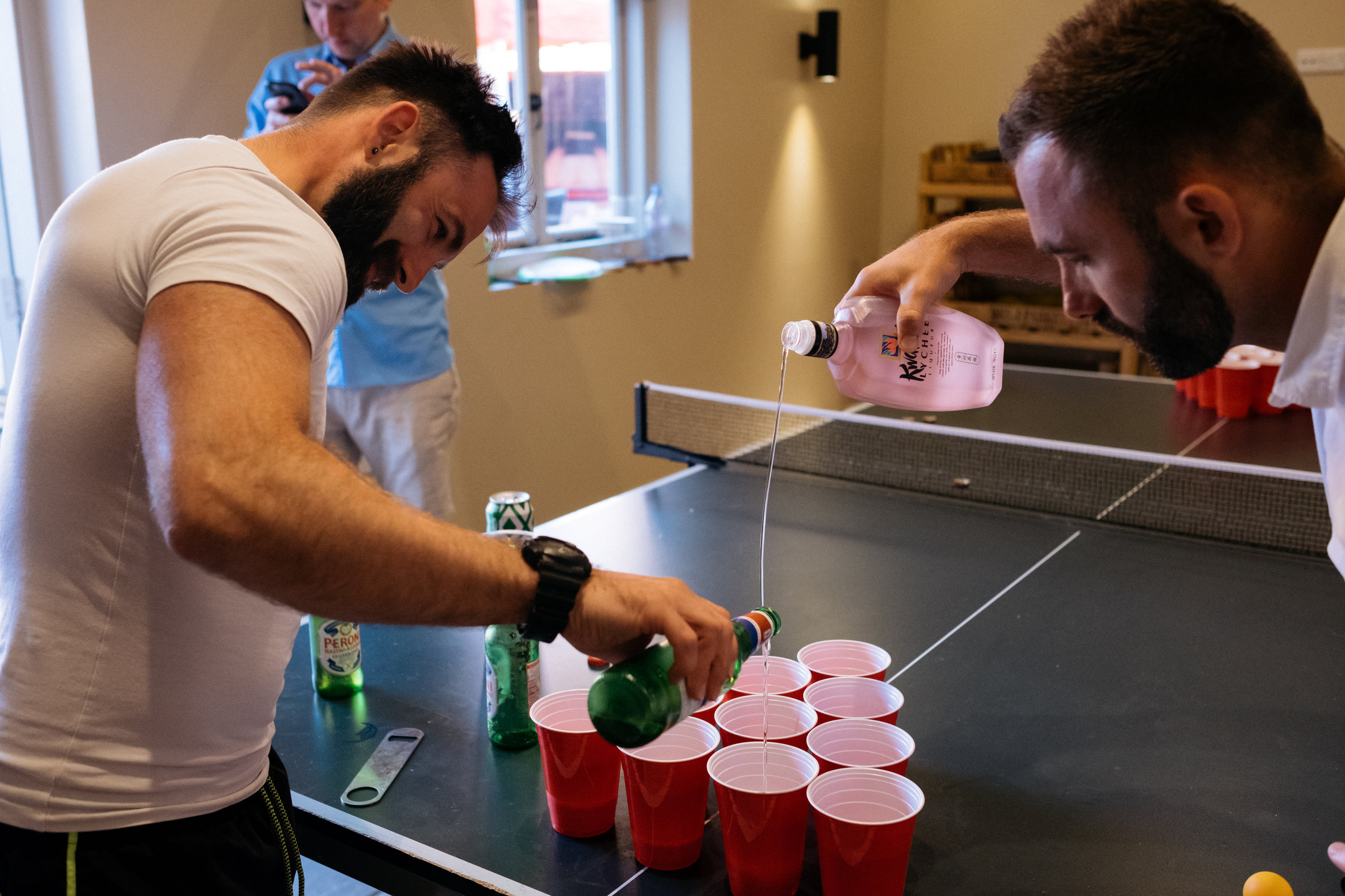 Beer pong at a relaxed wedding