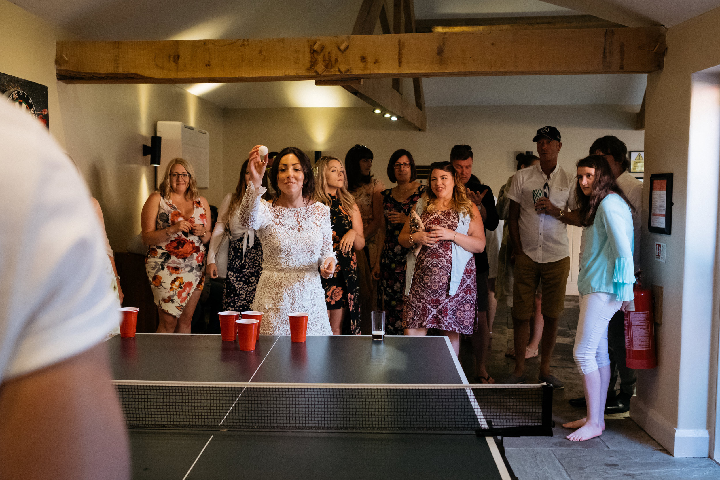 Bride plays beer pong during wedding