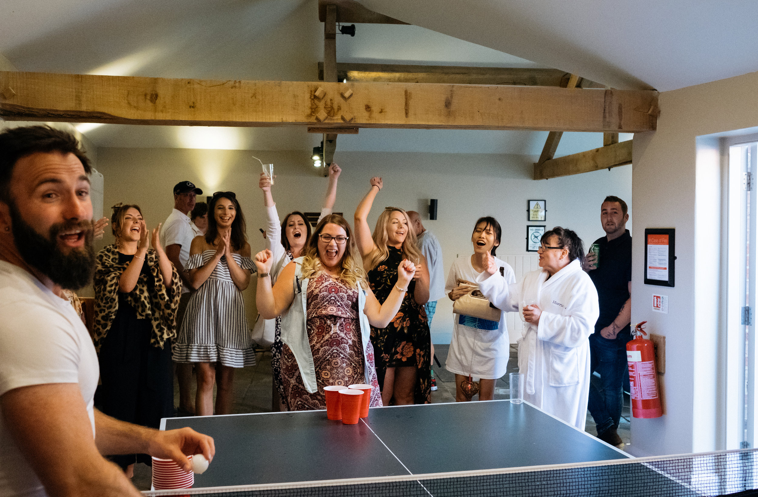 Team celebrate during wedding beer pong