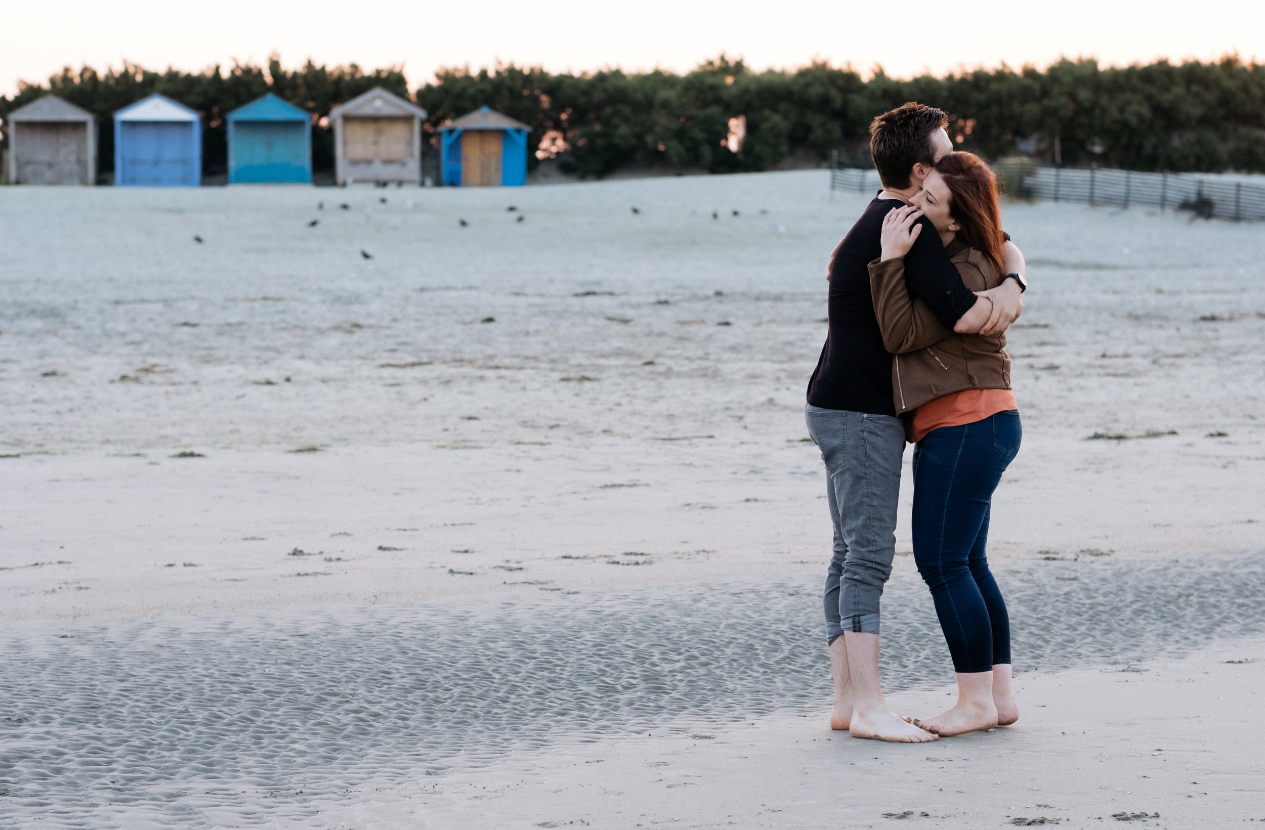 Engagement shoot on West Wittering beach at sunrise with beach huts