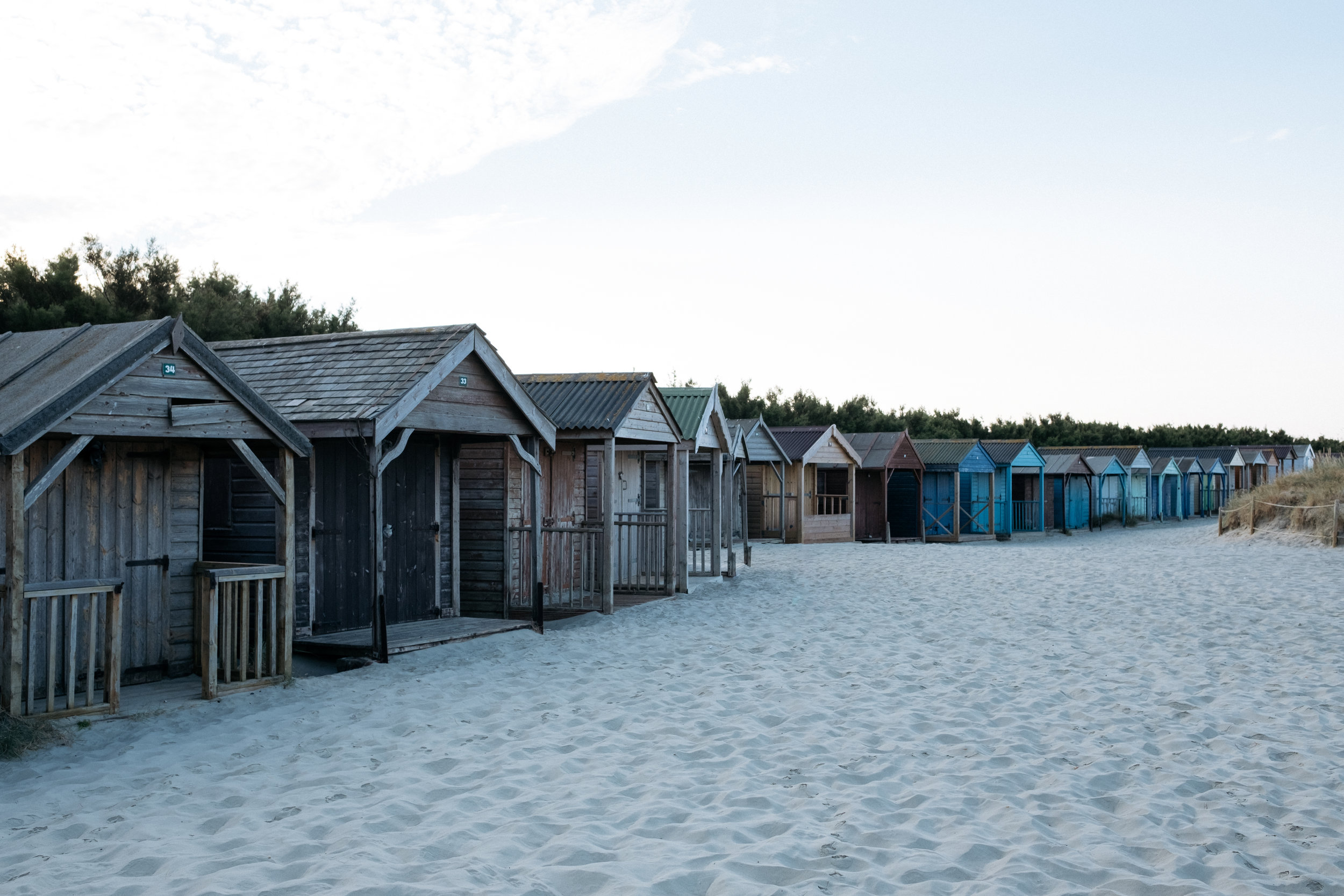 Beach huts on West Wittering beach at sunrise