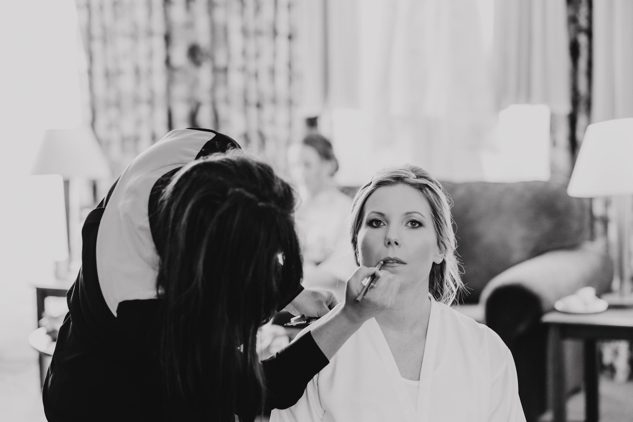 Bride having make up done on morning of wedding