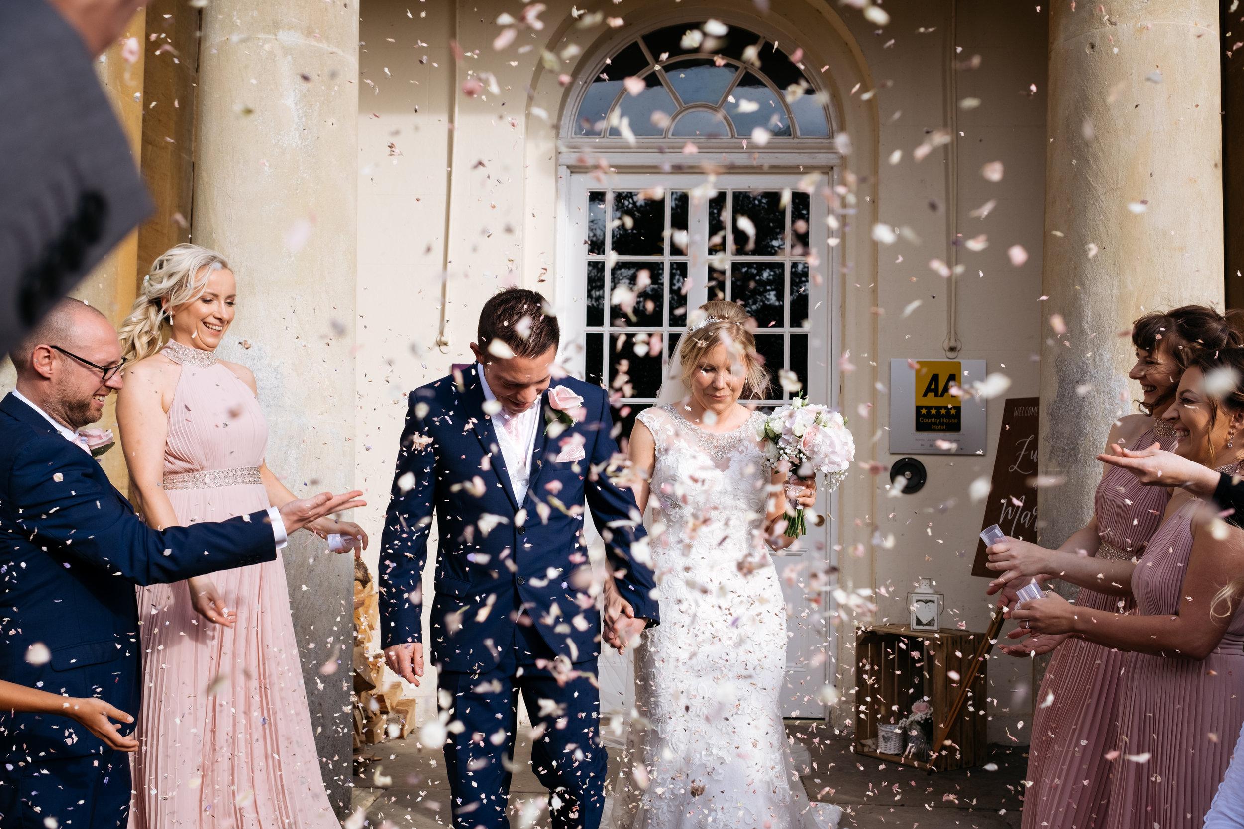 Confetti shot wedding at Mercure Newbury Elcot Park Hotel