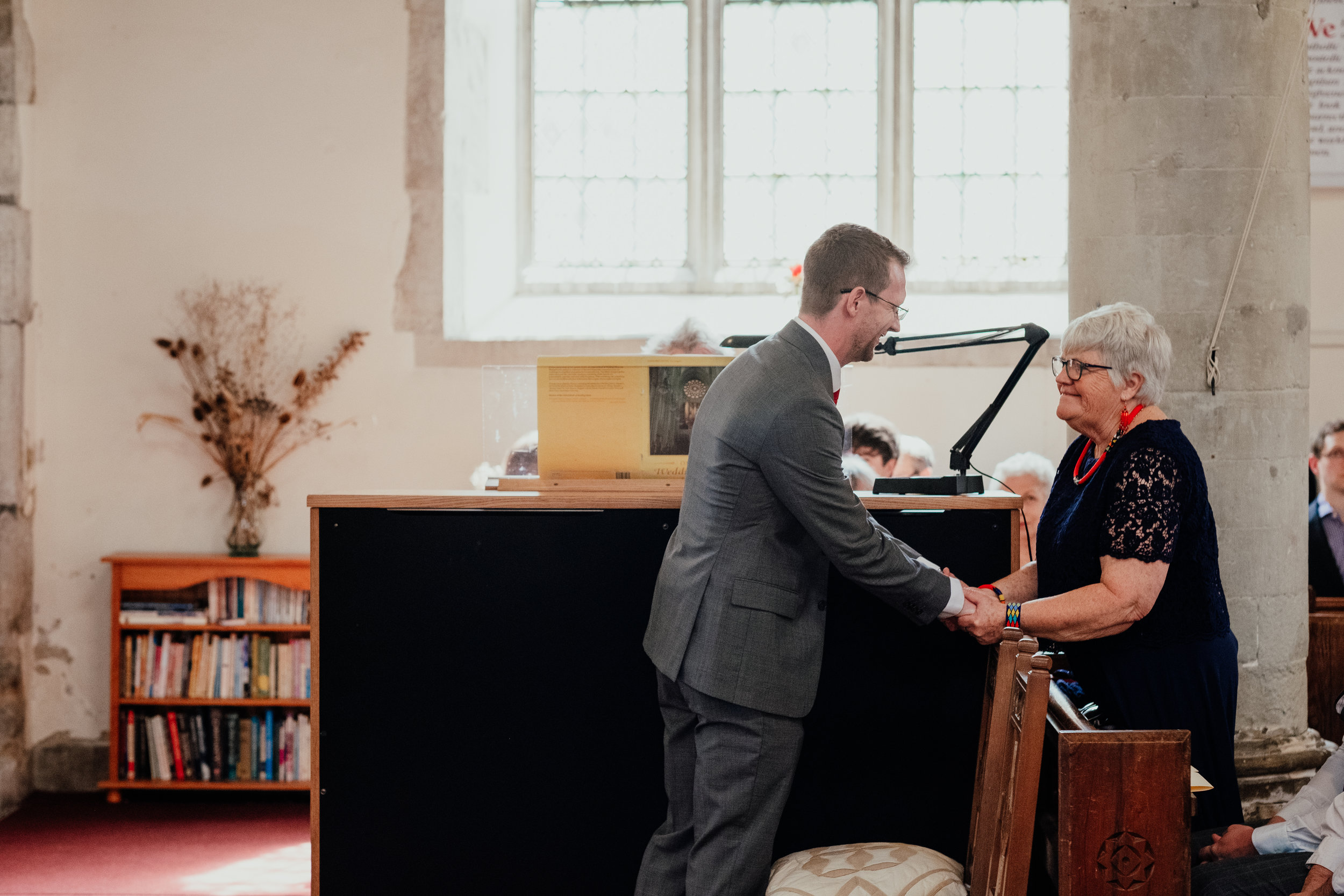 Groom speaking with his mum at the church before wedding