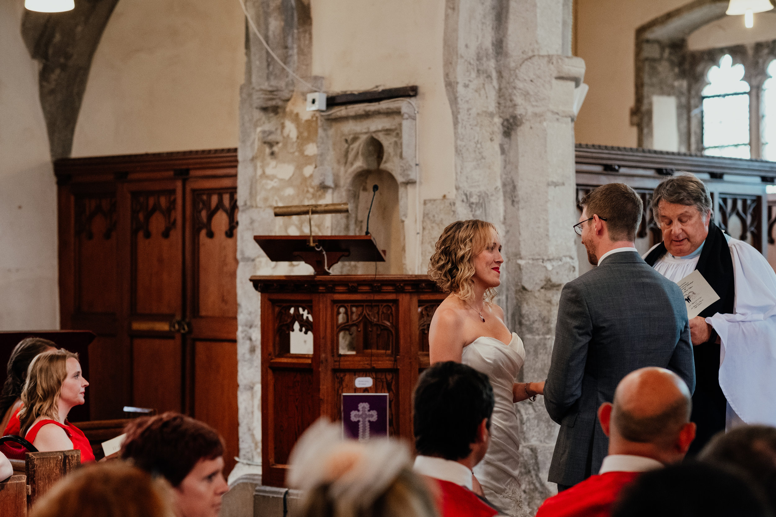 Bride and groom exchanging vows during church wedding