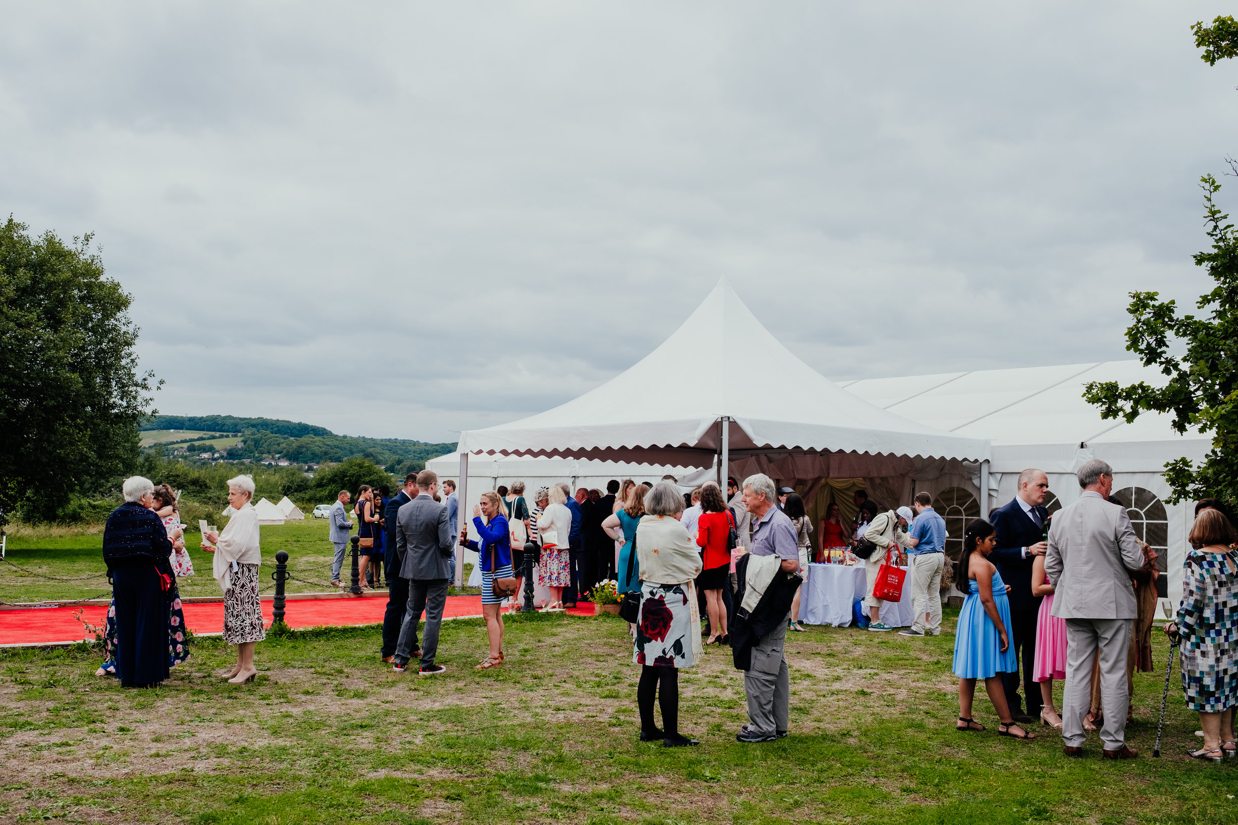 Wedding guests outside marquee