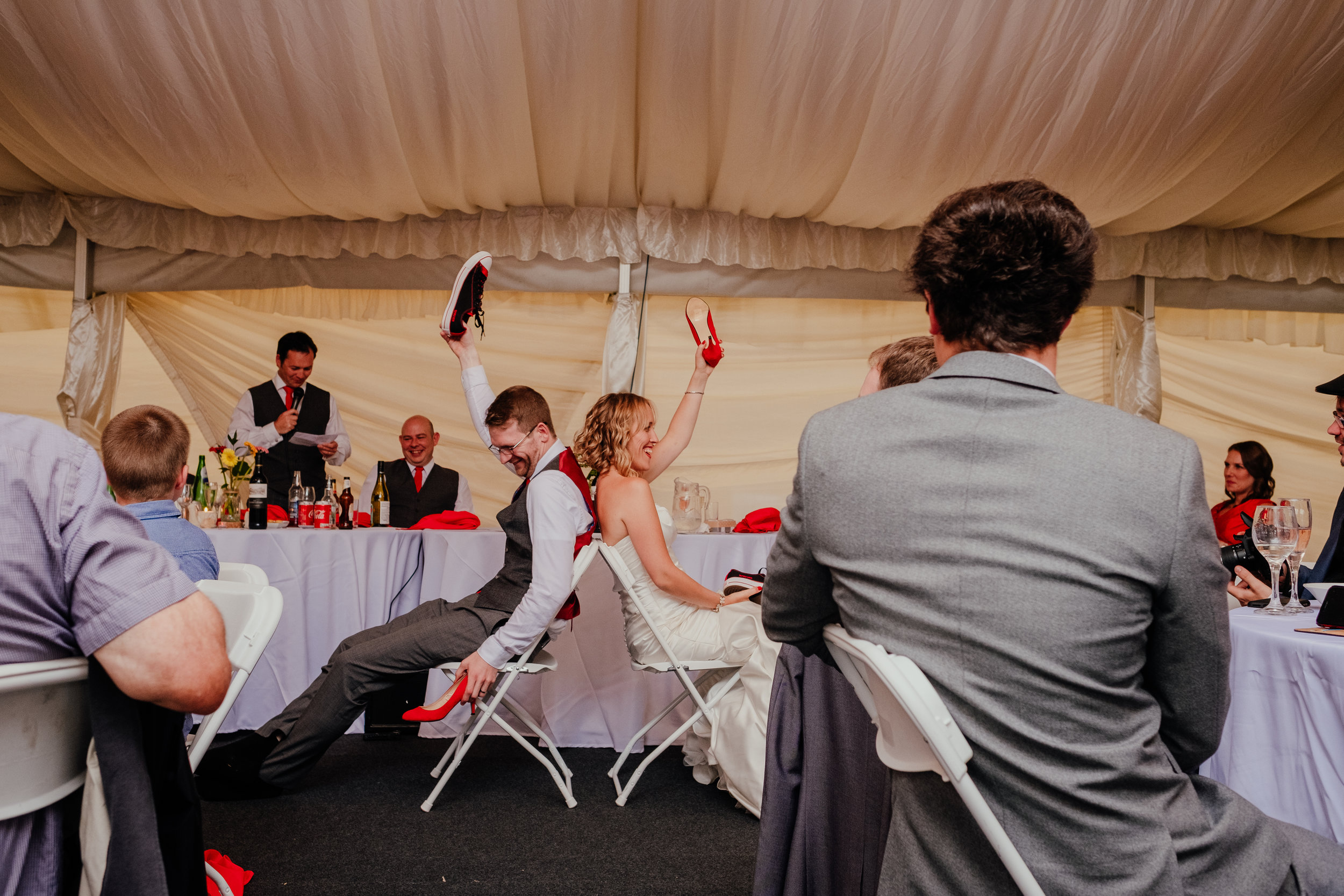 Bride and groom playing shoe game during reception