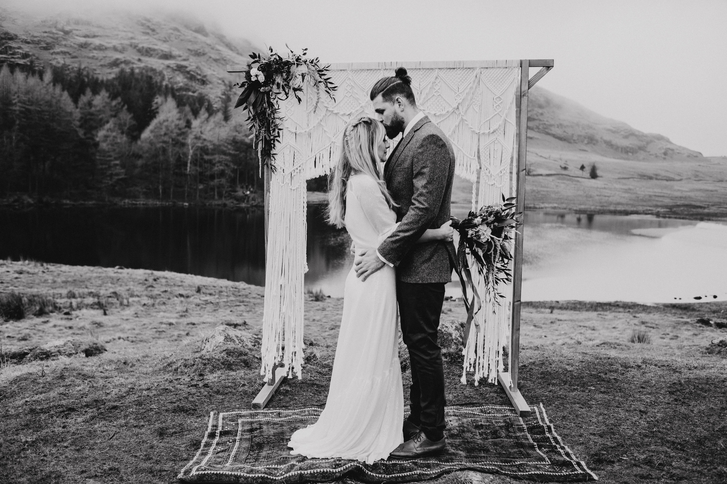 Groom kisses bride's forehead Lake District elopement photography