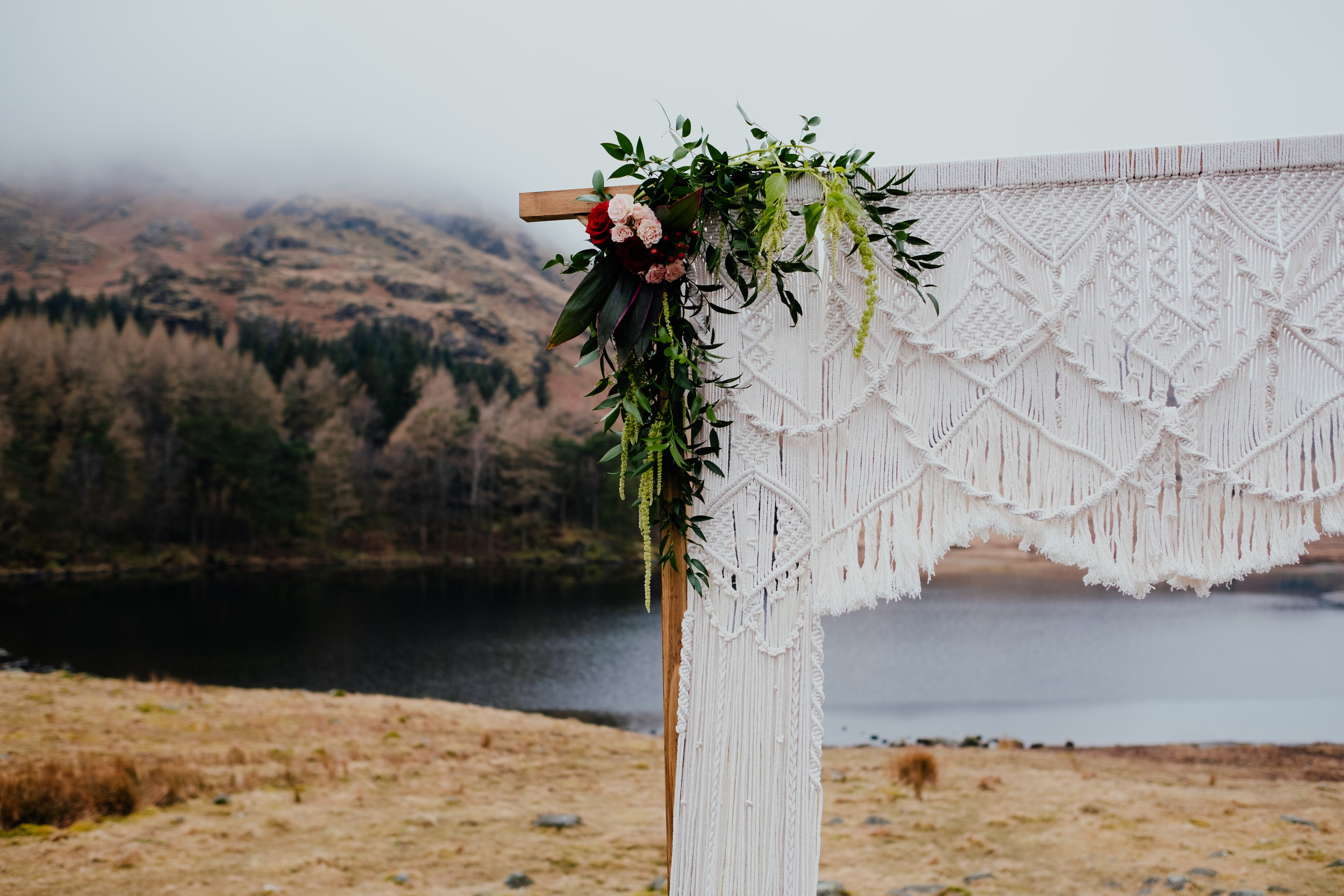 Beautiful macrame wedding altar and wedding flowers at elopement