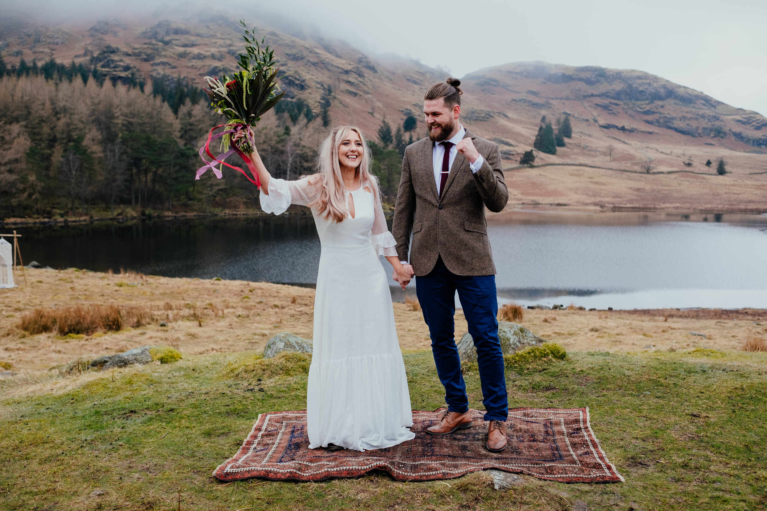 Bride and groom celebrating after getting married during Lake District elopement
