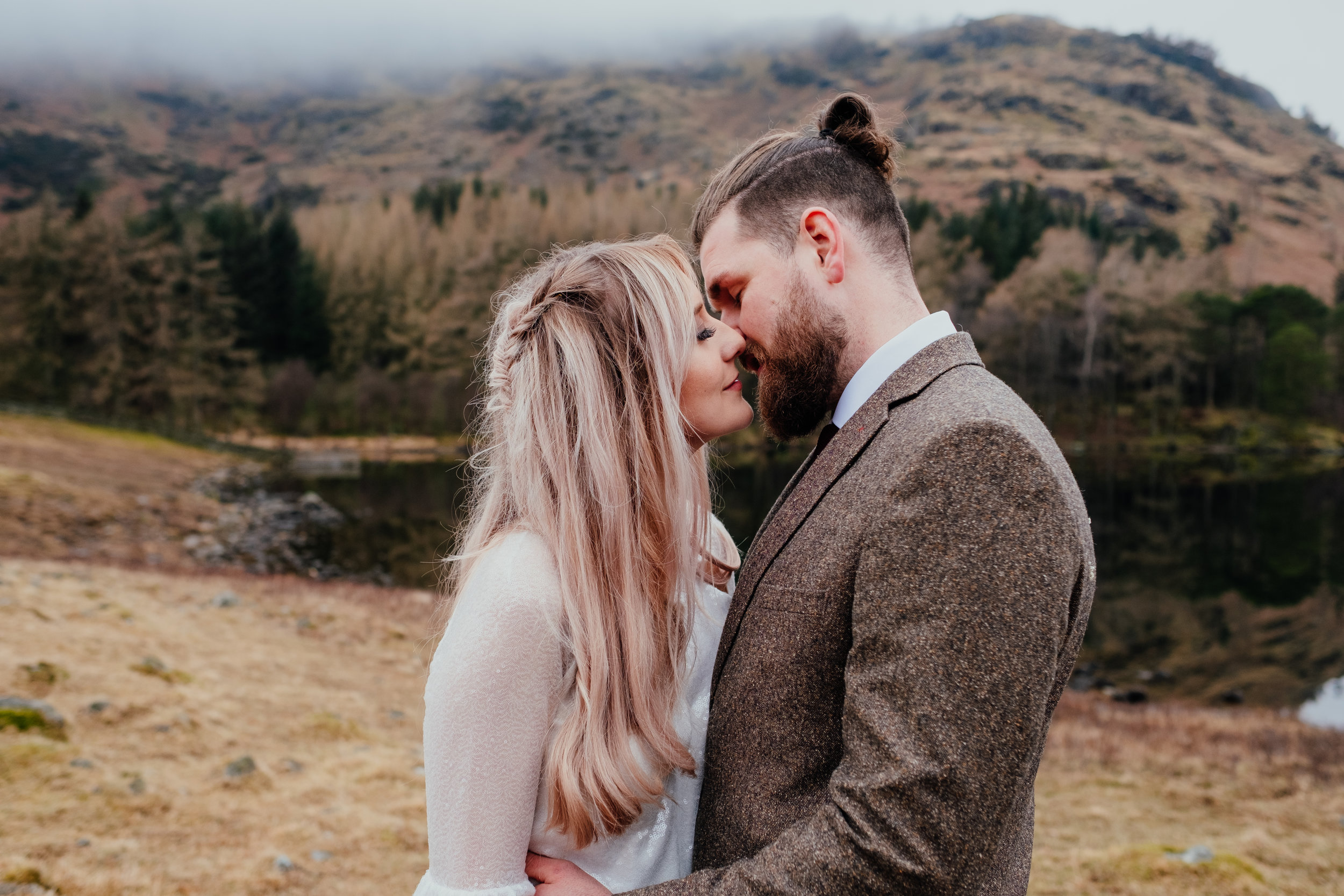 Bride and groom about to kiss after eloping in the Lake District