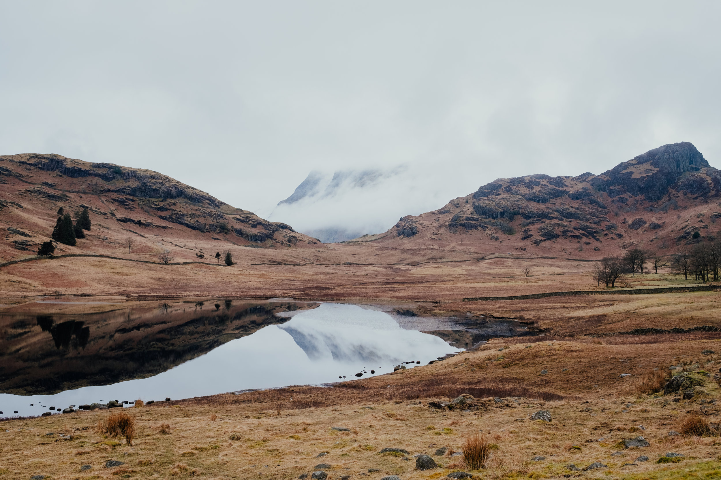 Blea Tarn in the Lake District covered in mist