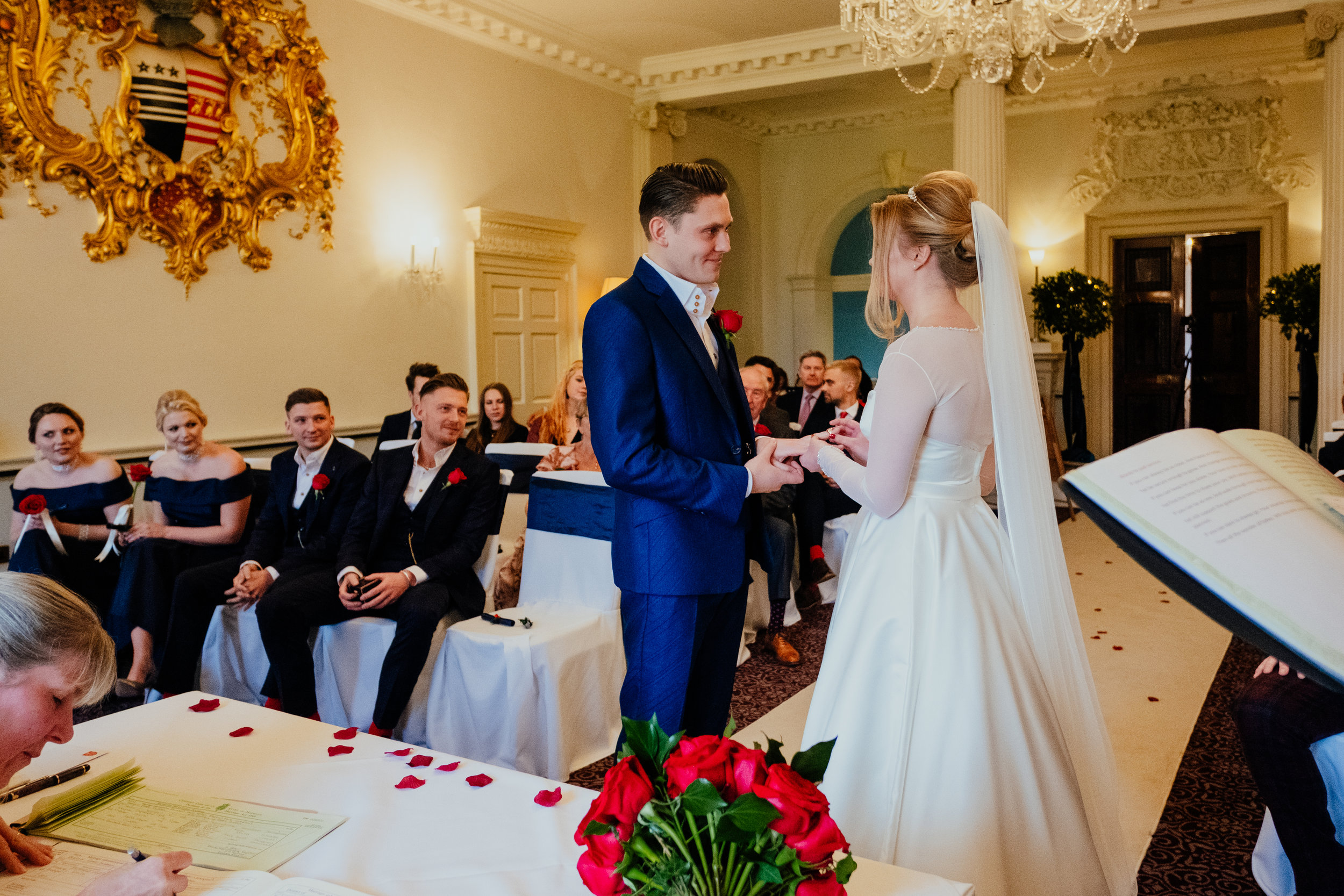 Buxted House Hotel wedding bride and groom exchange vows