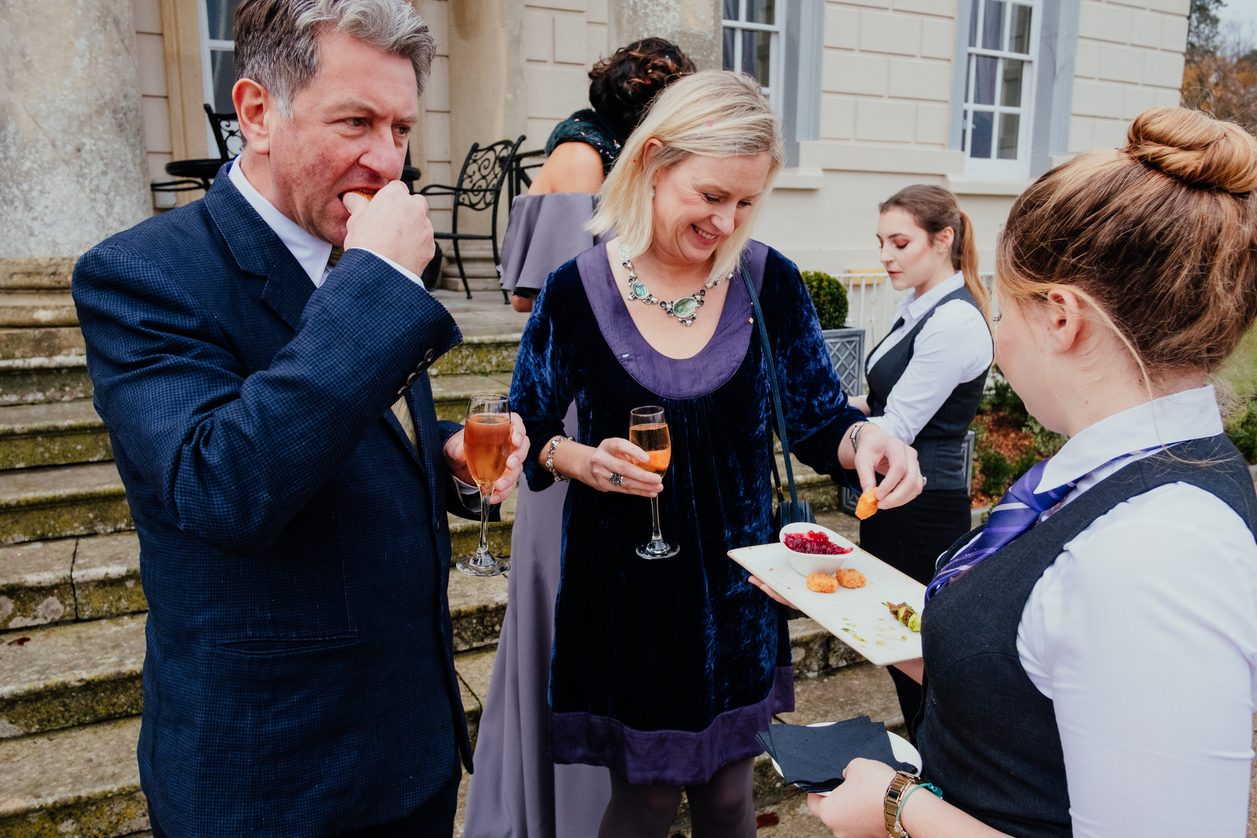 Buxted House Hotel wedding guests eating canapés outside