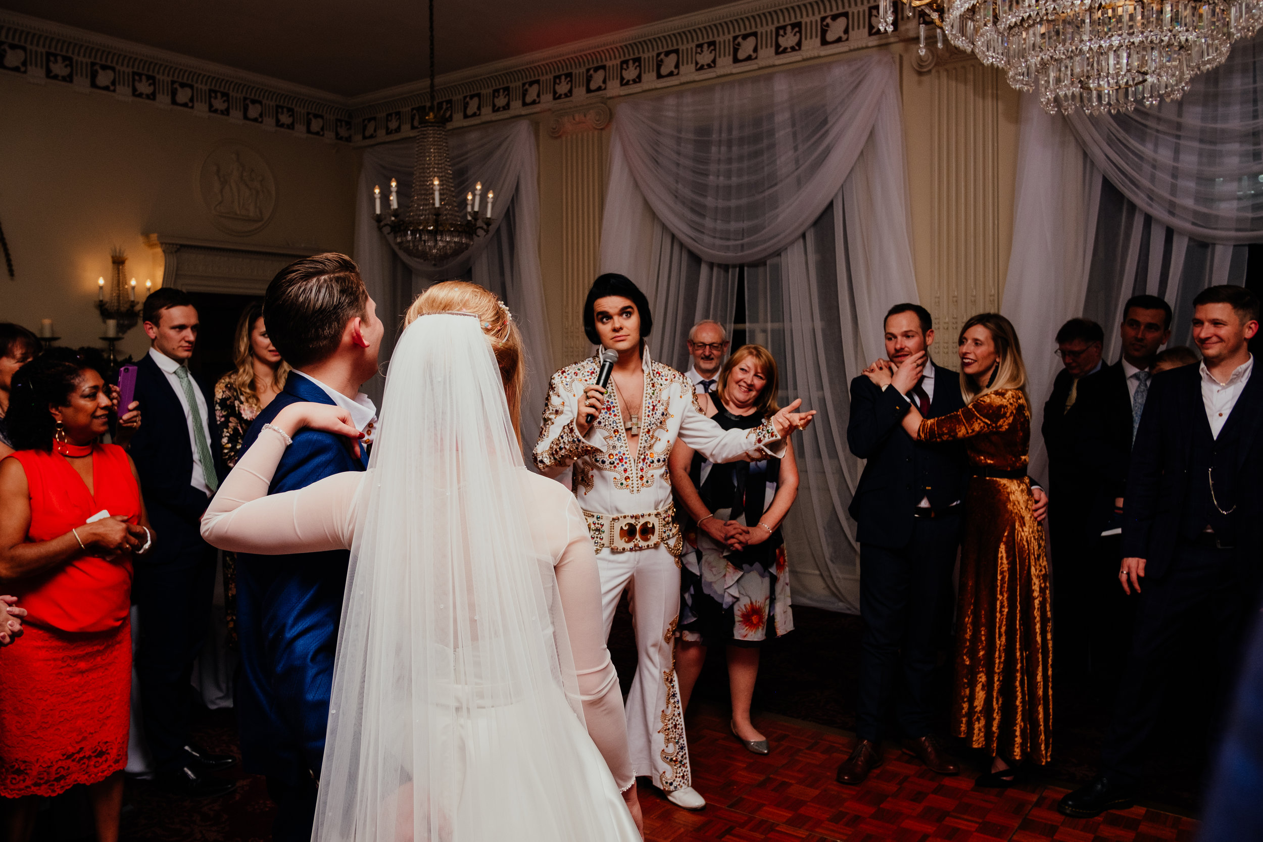 Buxted House Hotel autumn wedding first dance with Elvis impersonator