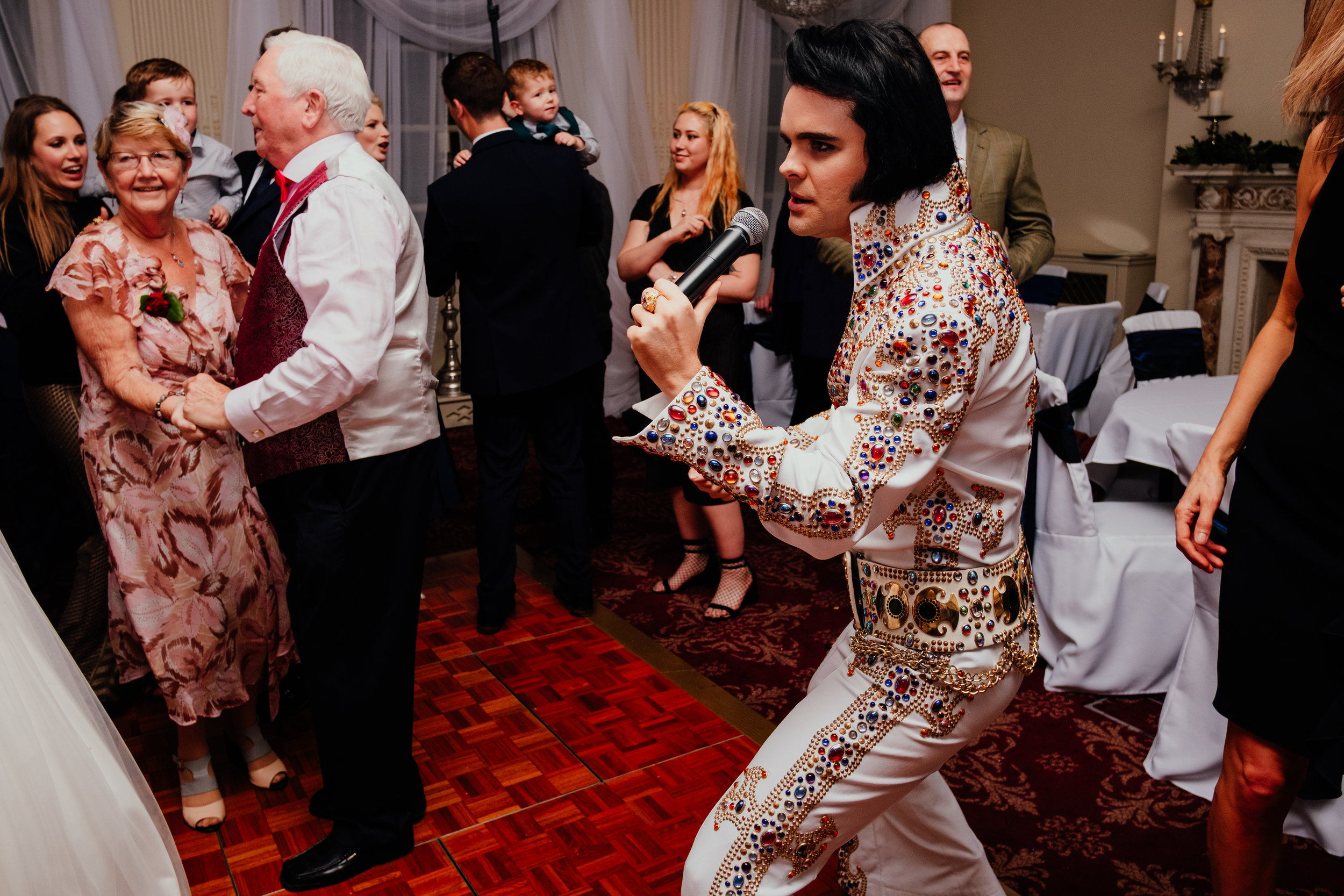 Buxted House Hotel wedding Elvis singing for wedding guests