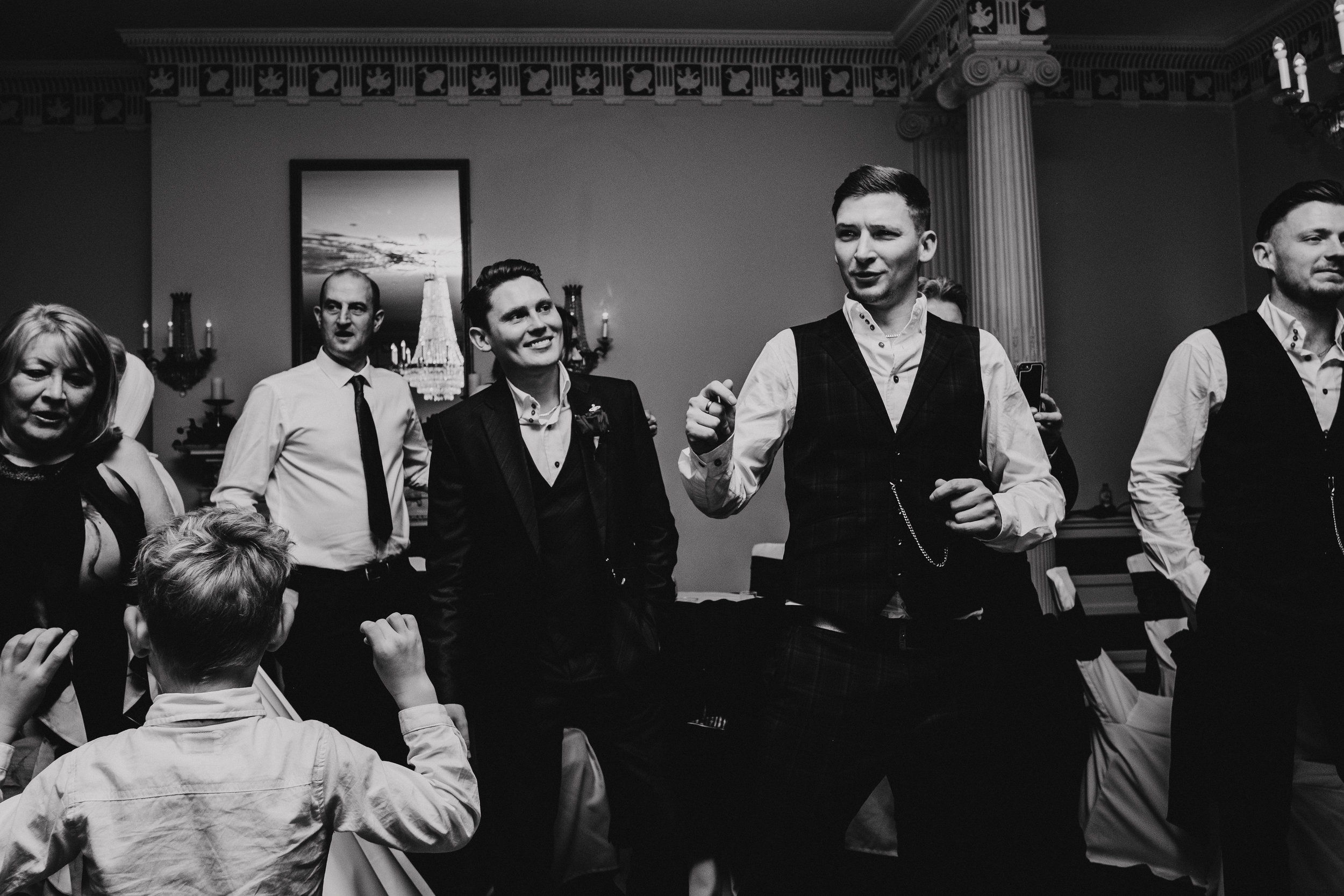 Buxted House Hotel Groom and groomsman singing along to Elvis