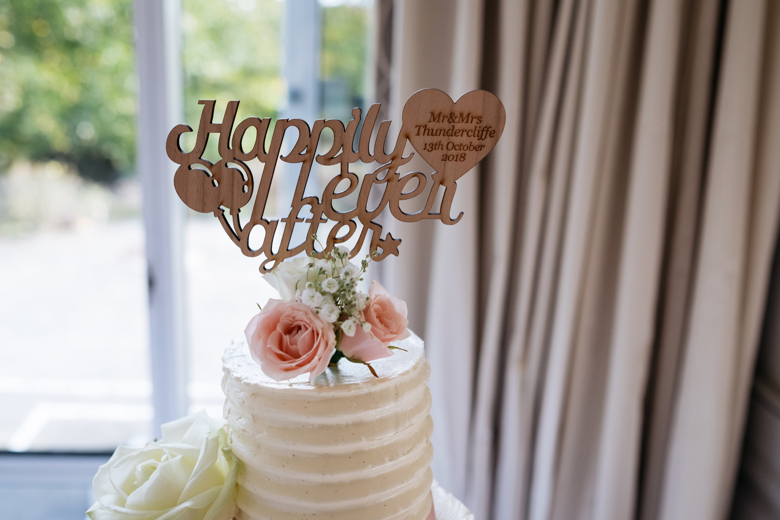 Happily ever after cake topper personalised with bride and groom's names and wedding date