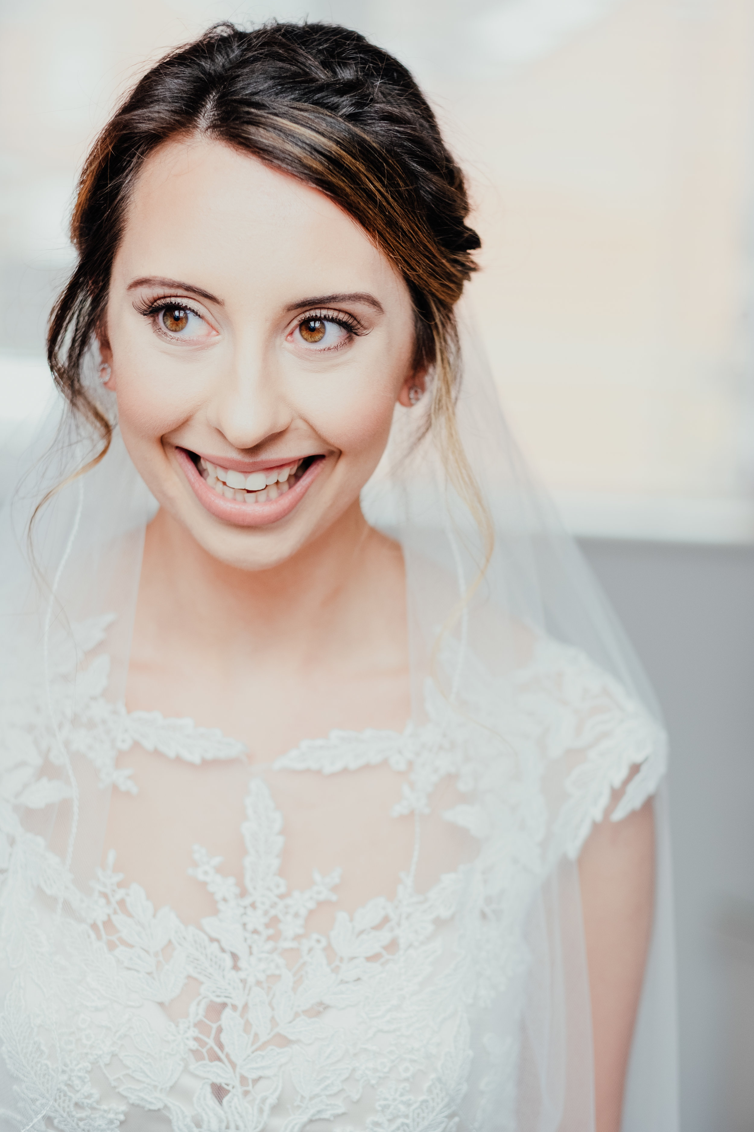 Bride laughing in bridal portrait