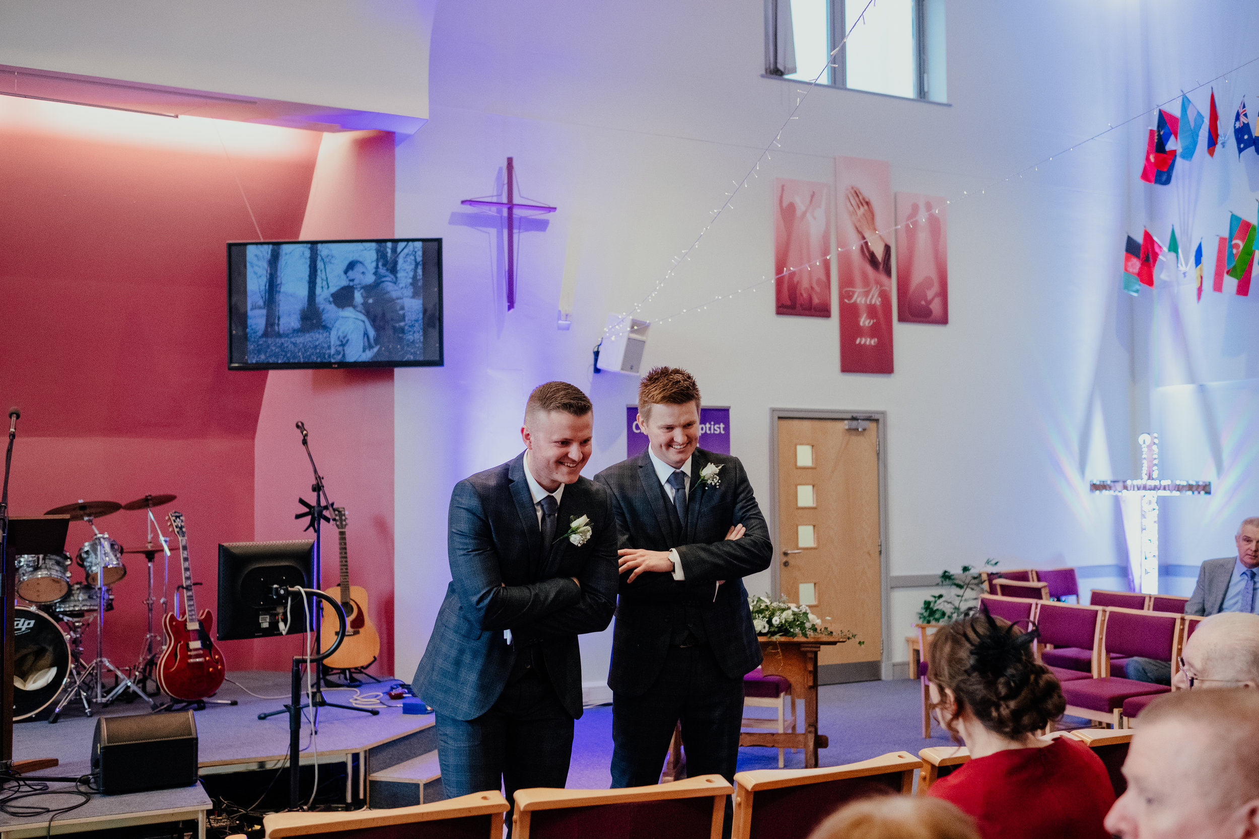 Groom and Best Man wait at church for bride to arrive