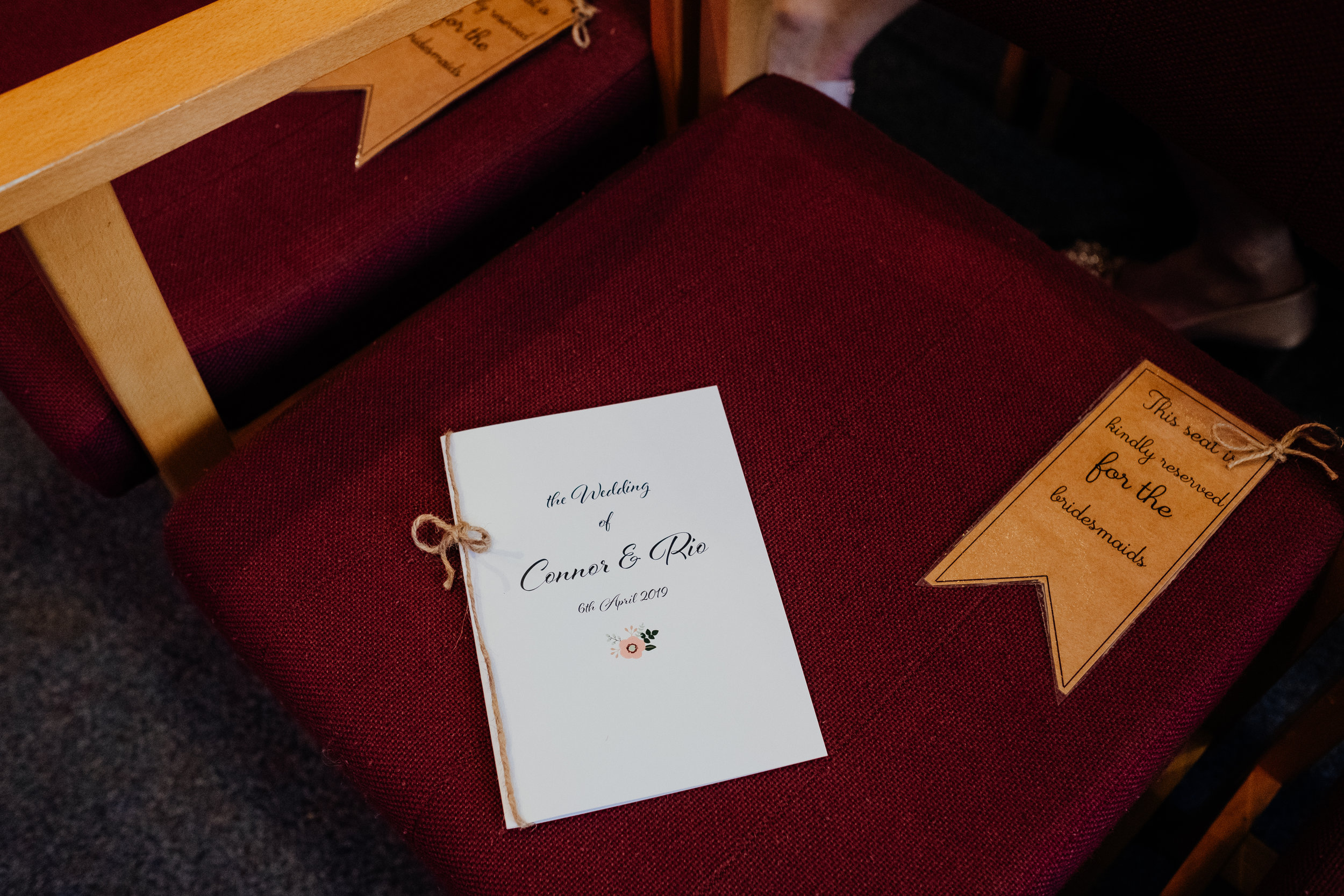 Wedding day order of service on chair at ceremony