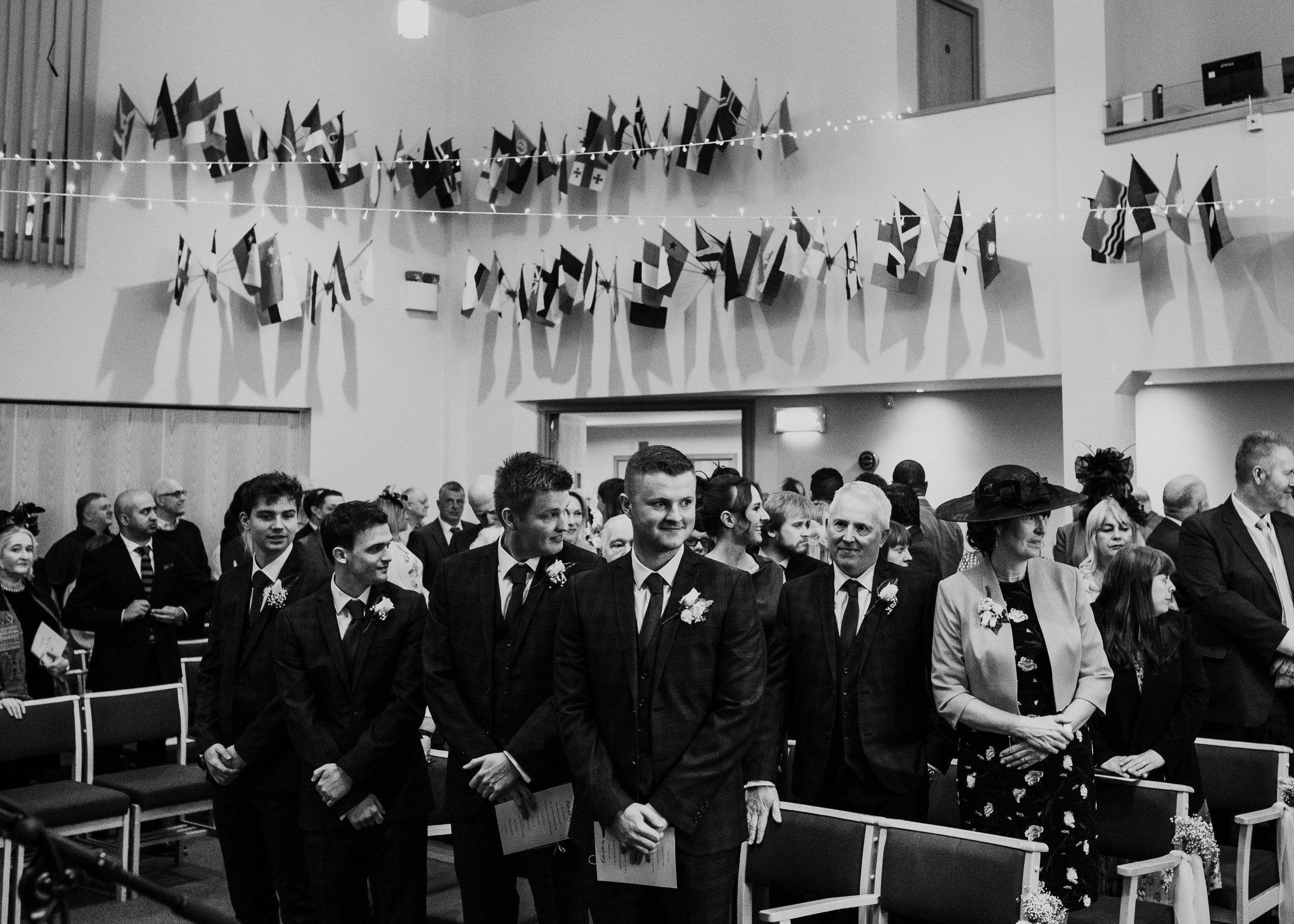 Groom and groomsmen wait for bride in the church